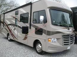 Outside has awning with lights, TV, 110 Outlet, Barbecue. Thor Motor Coach A.C.E 2015