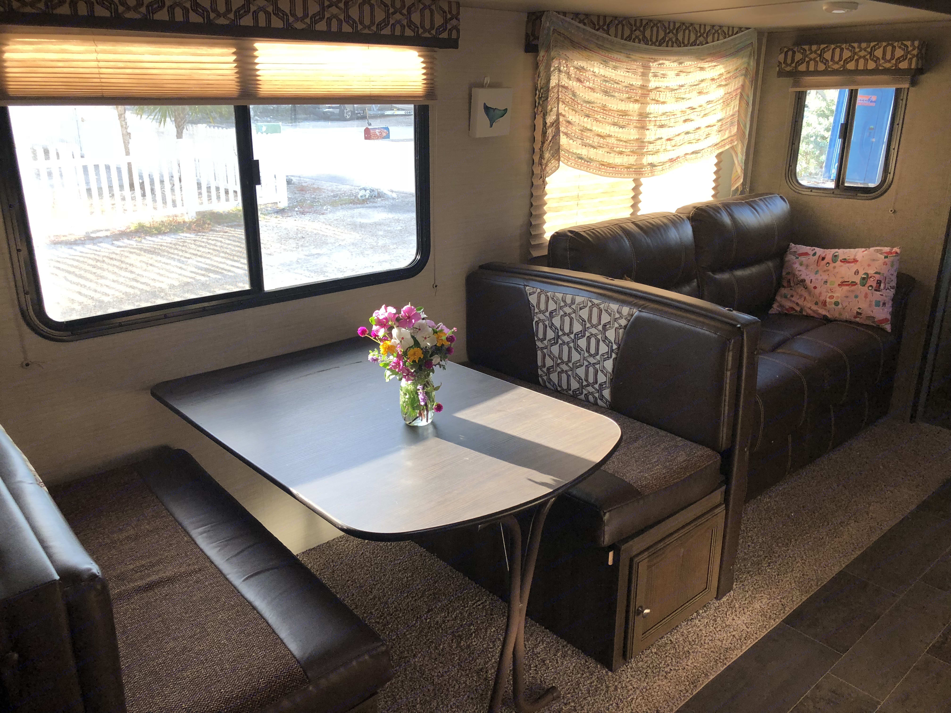 Dinette and couch both convert to befs. Keystone Bullet 2017