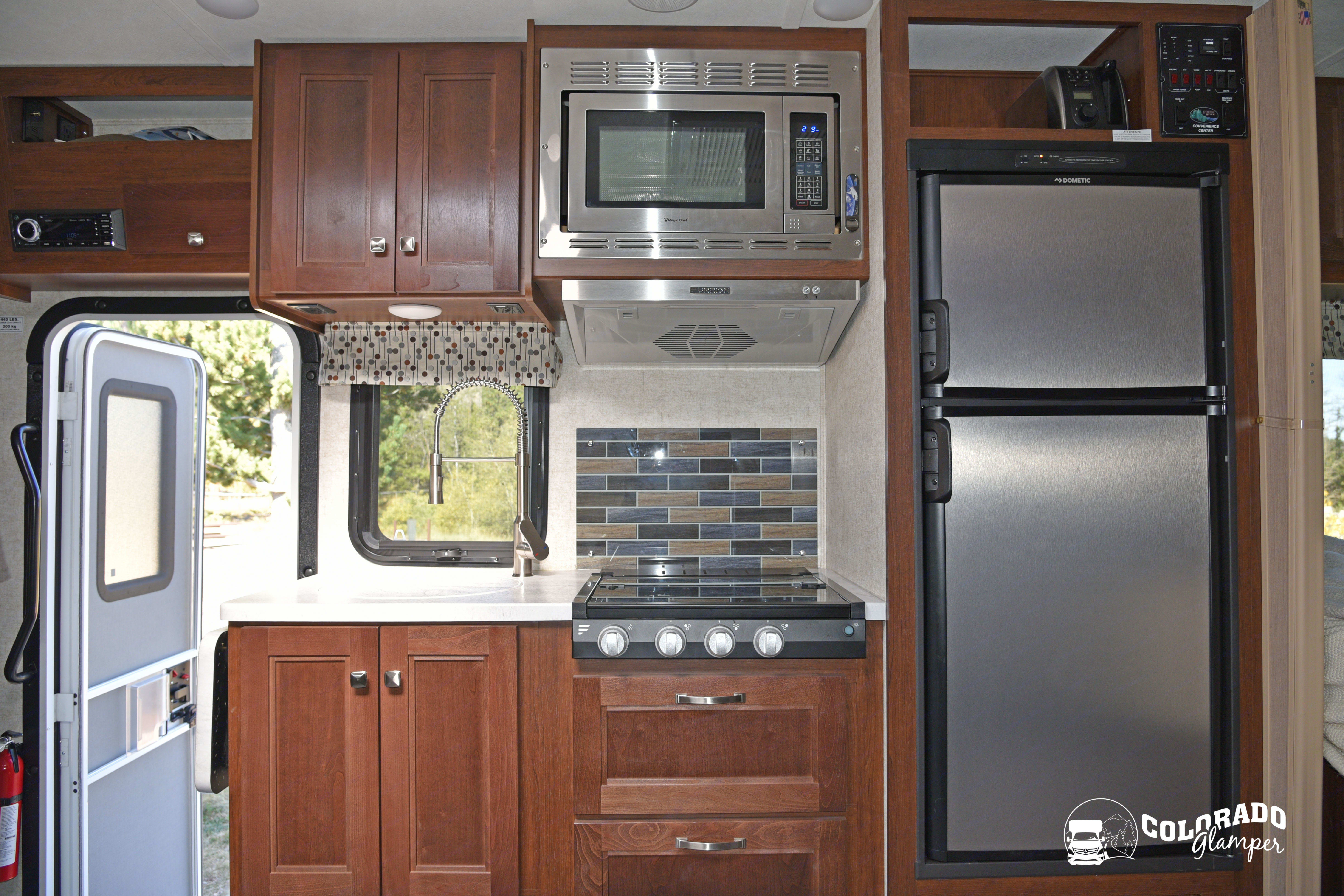 Fridge runs off electric or propane. Forest River Sunseeker 2019