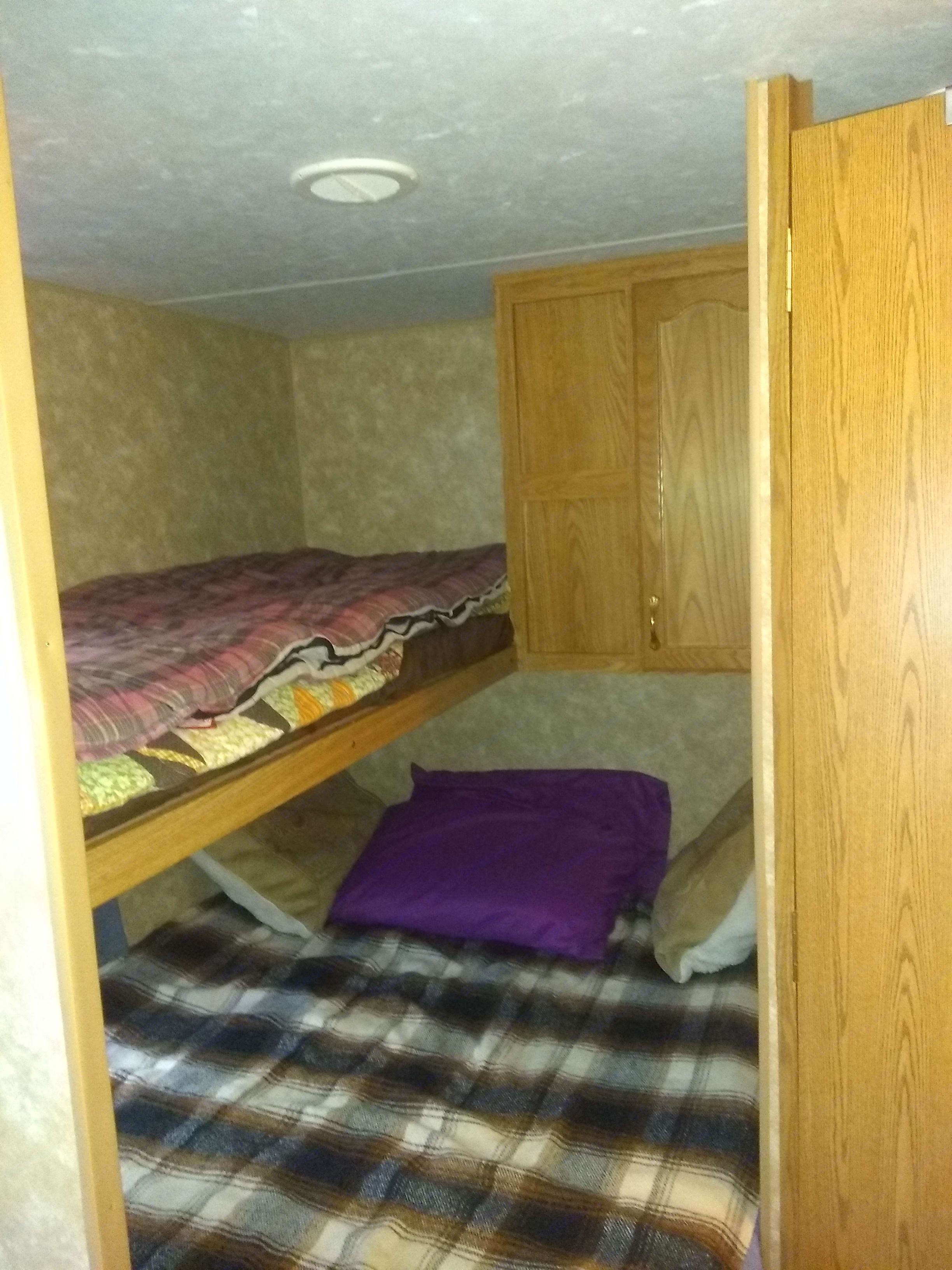 Main bed sleeps  2 adults, w/ bunk bed above. Sleeps one adult or two kids. Jayco Riverside 2006