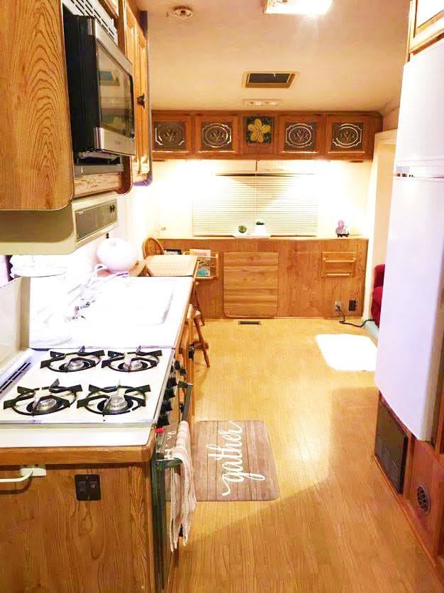 Full size refrigerator and kitchen, we have lots of plates cups and utensils . Liteway Other 1970