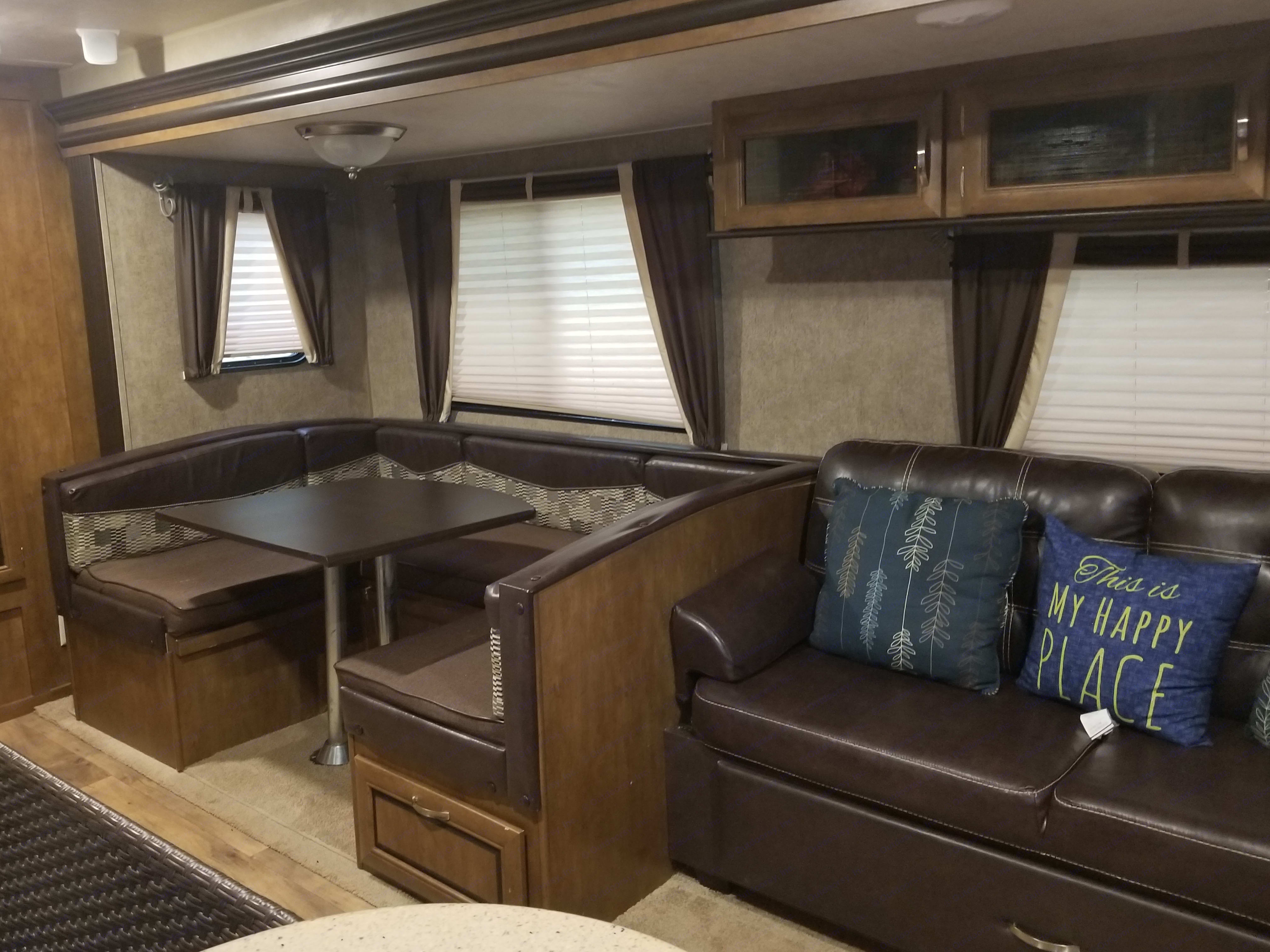 Dinette which converts into a bed.  The sofa folds down like a futon for another bed.. Forest River Wildwood 2016