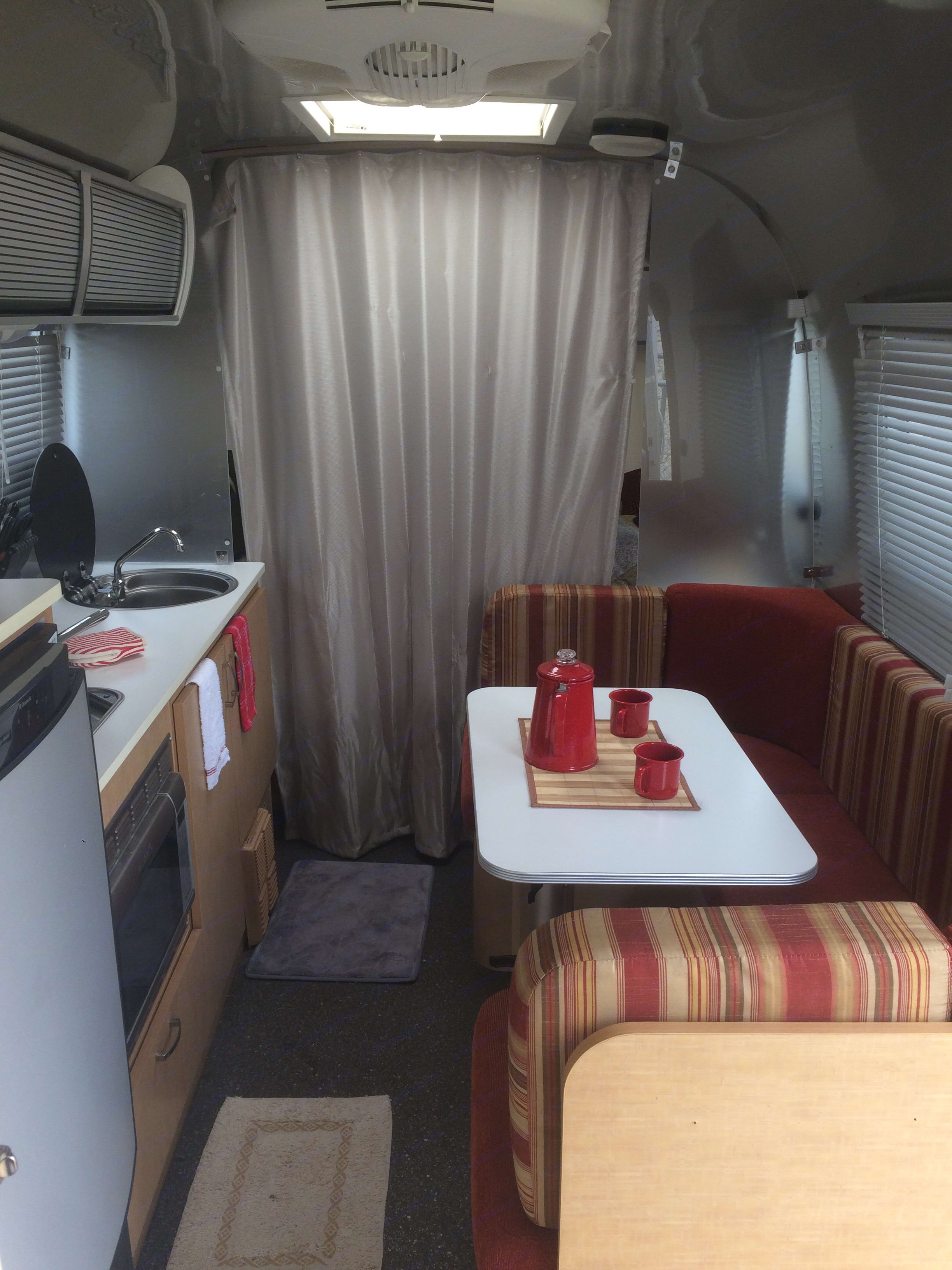 Looking toward the front with privacy curtain shut. . Airstream Sport 2012