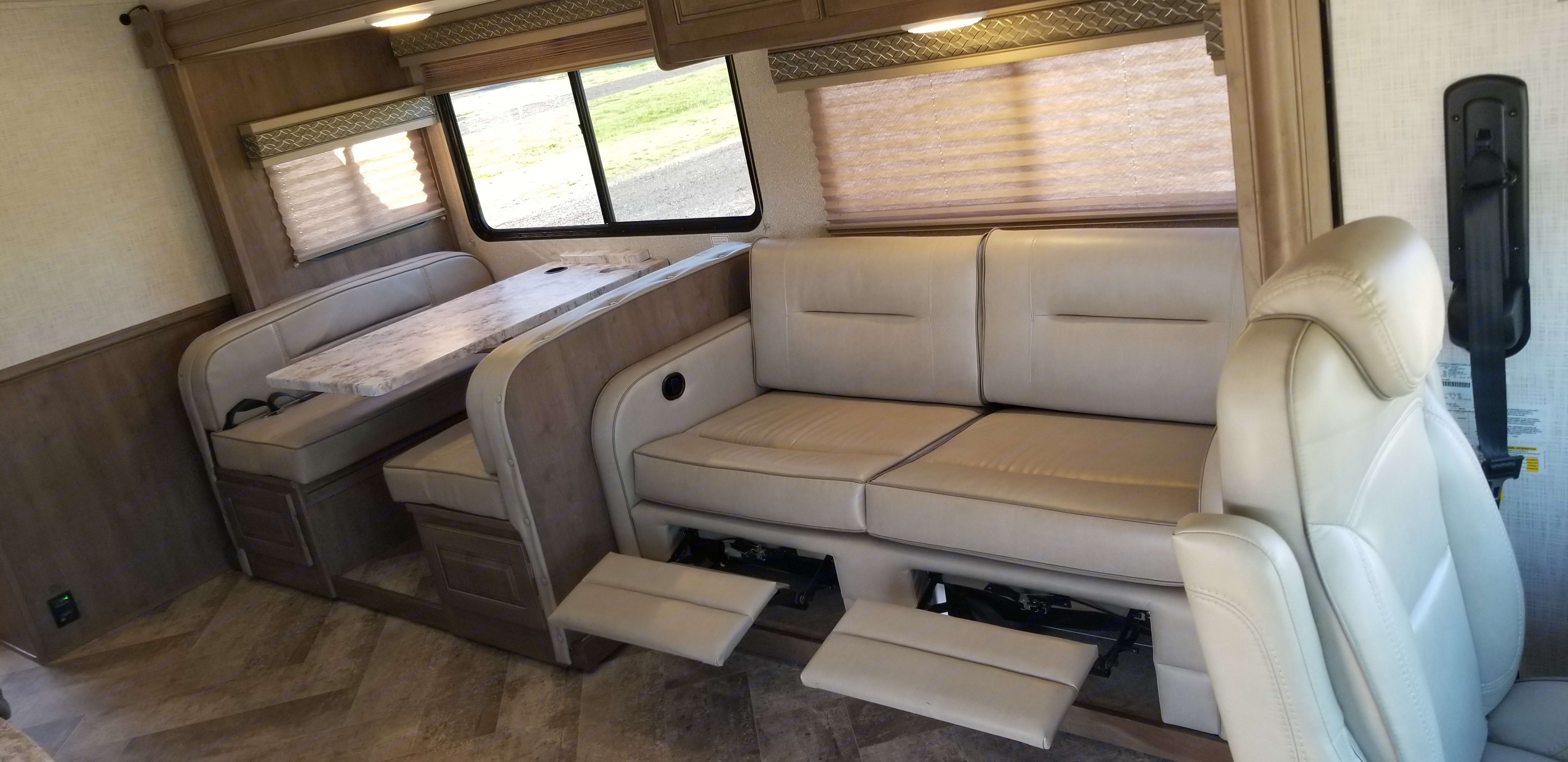 Dual footrests on the sofa that has a full size hide-a-bed.. Forest River Fr3 30X3 2018