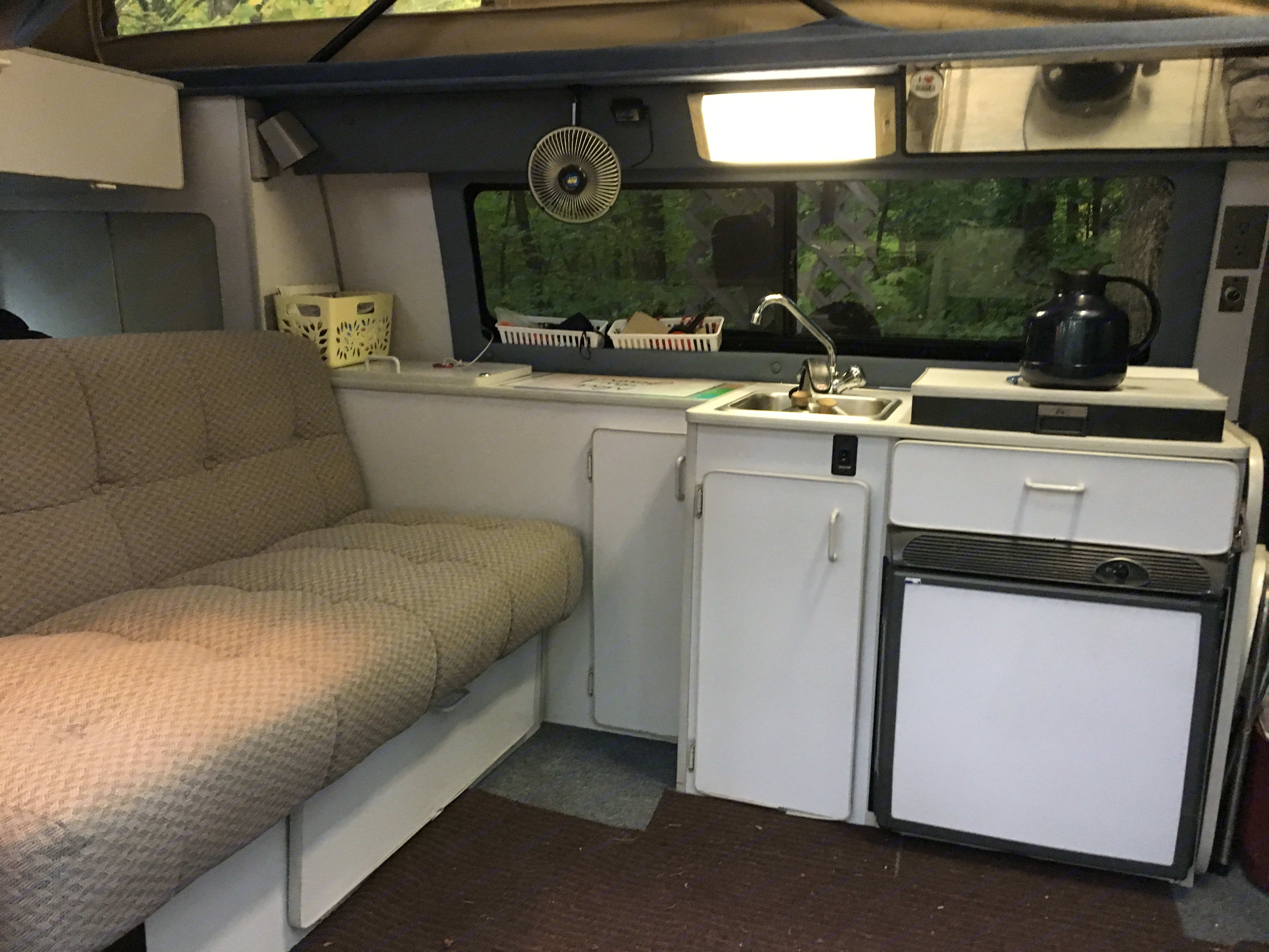 Kitchen area. Sportsmobile Custom Design 2003