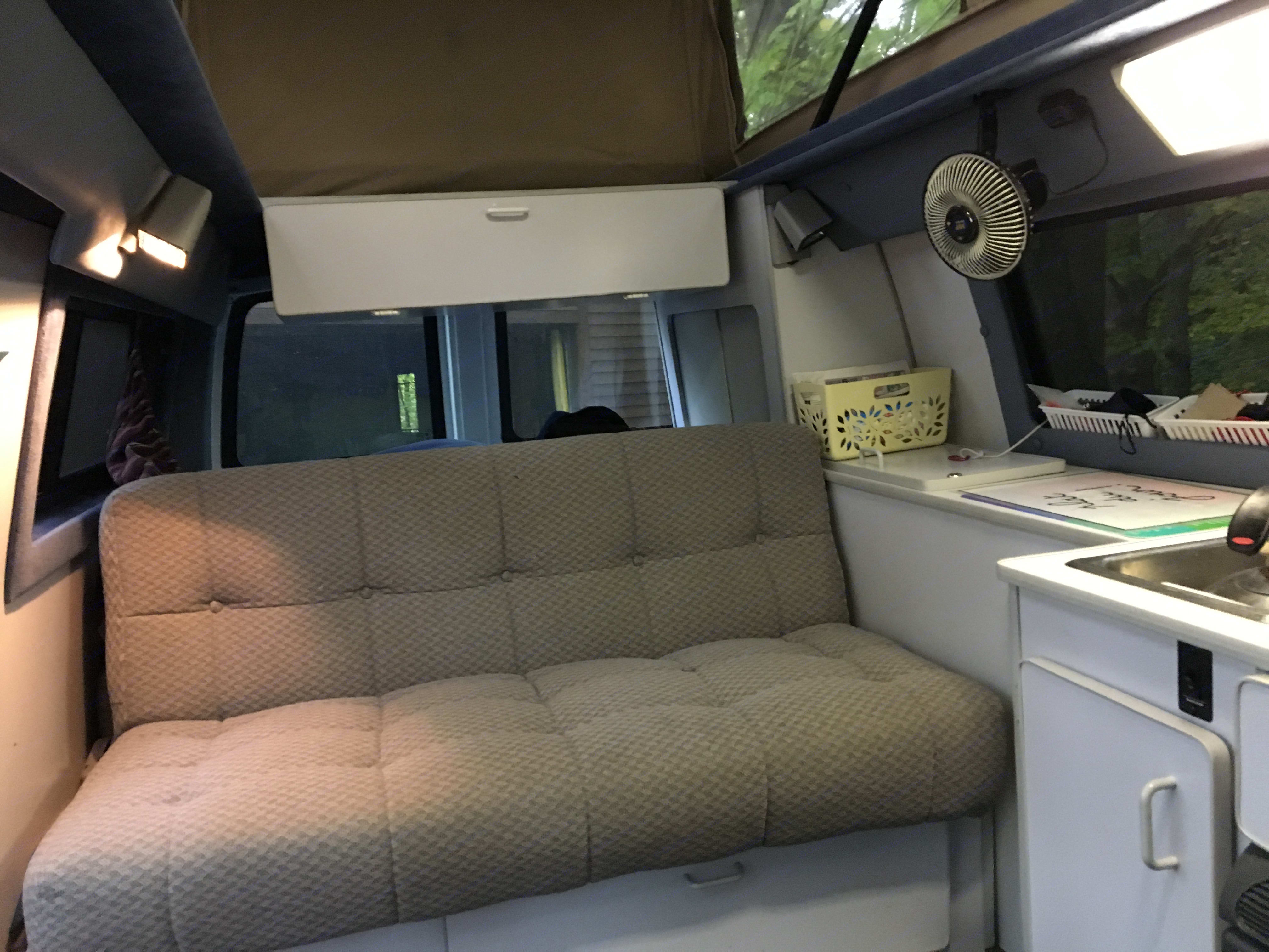 Back seat and storage areas. Sportsmobile Custom Design 2003