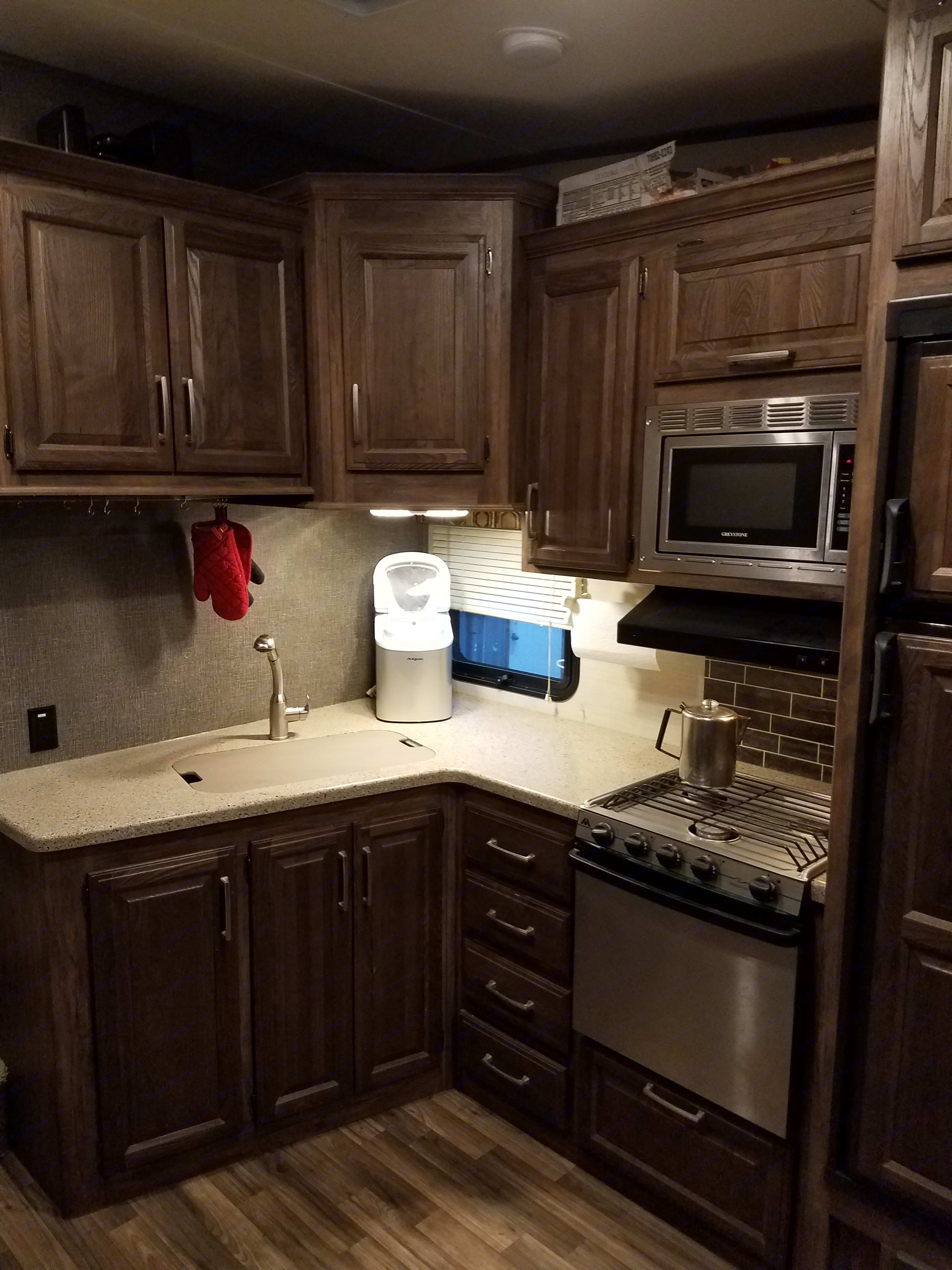 Kitchen, is fully stocked with plates utensils,  and pots and pans non stick and cast iron. Keystone Cougar 2016