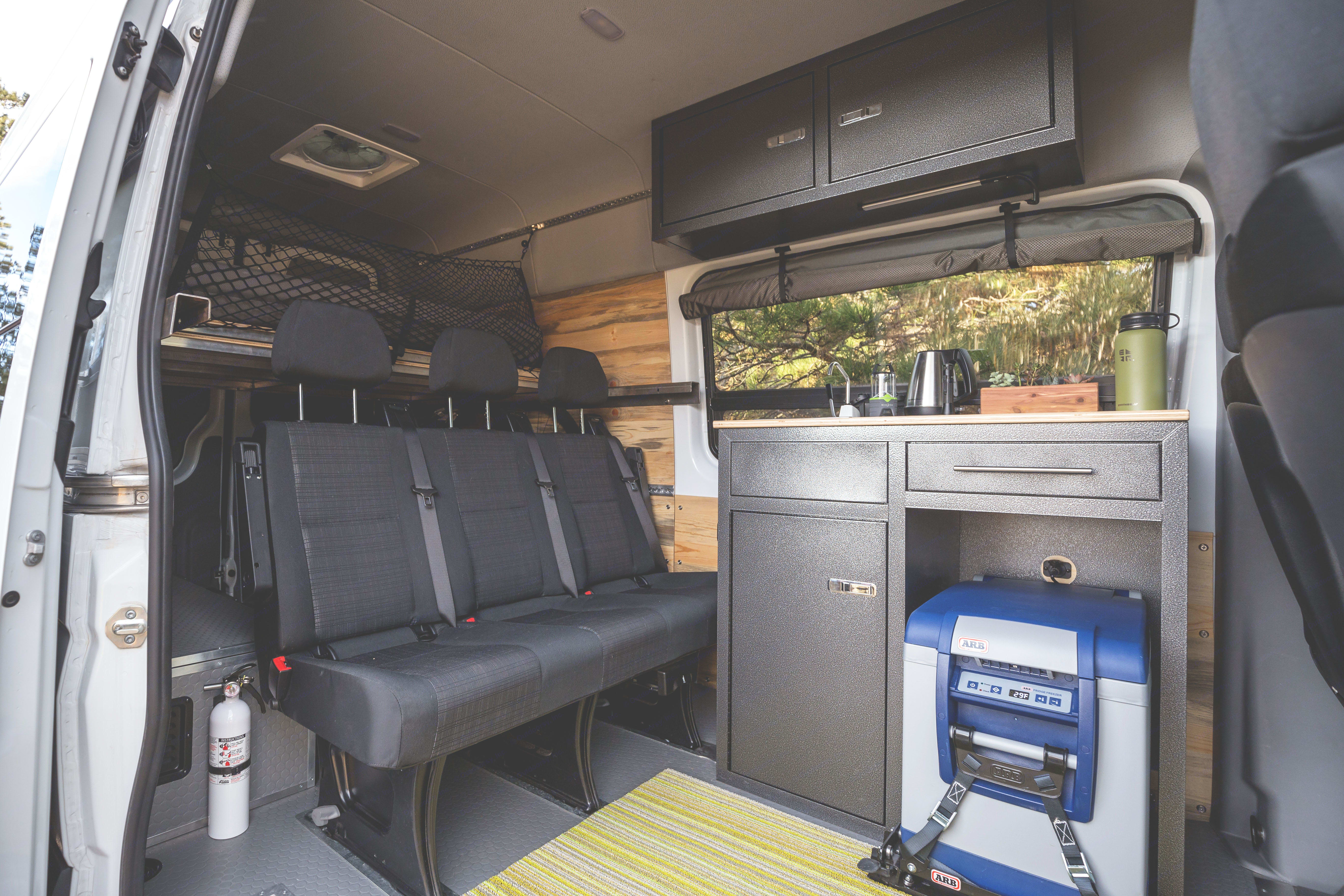 Custom kitchen with sink, counter space and programmable fridge. Mercedes-Benz Sprinter 2016