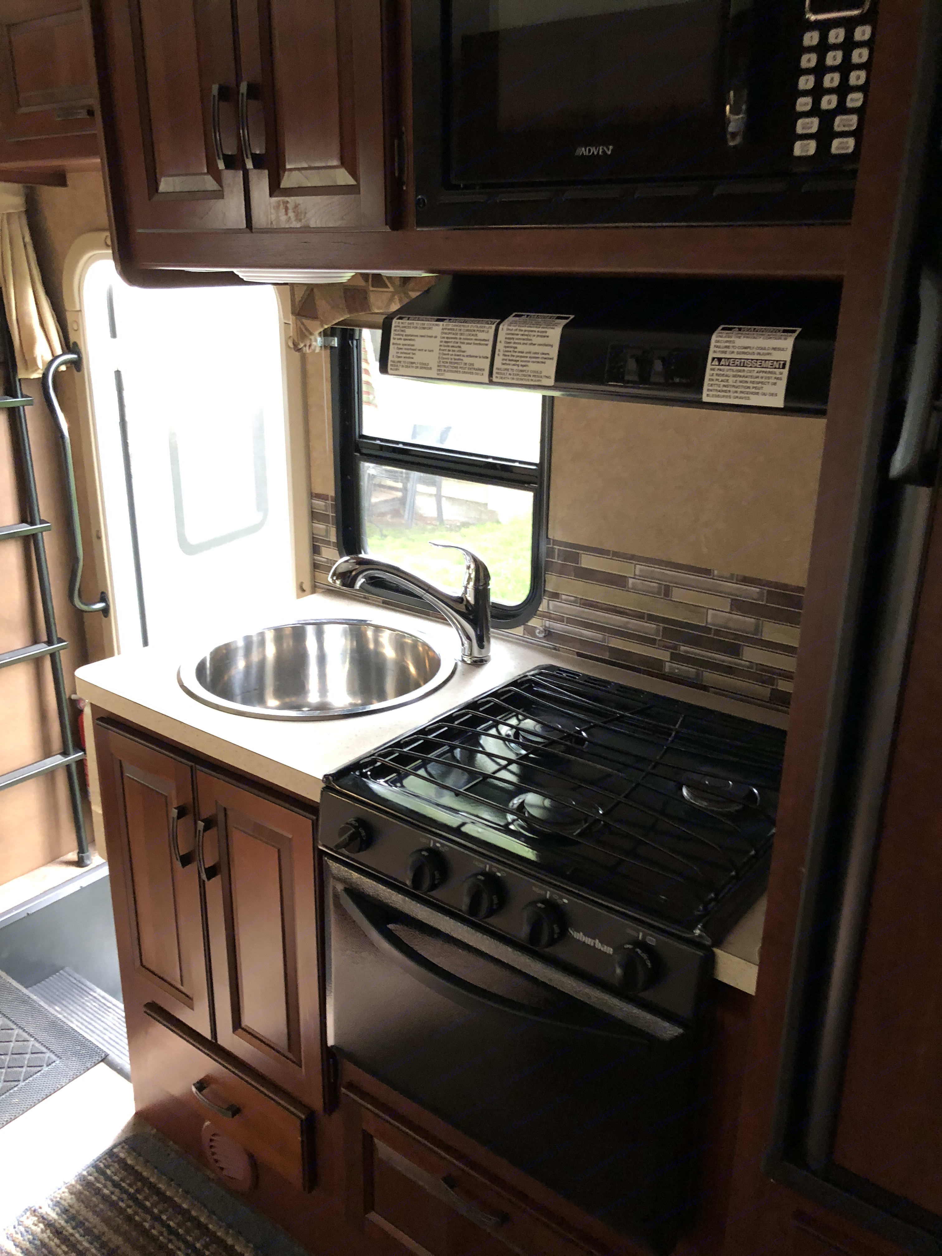Stove and sink.. Forest River Sunseeker 2015