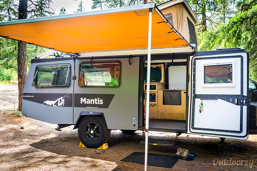 Stock photo showing awning. TAXA Outdoors Mantis Camper 2019