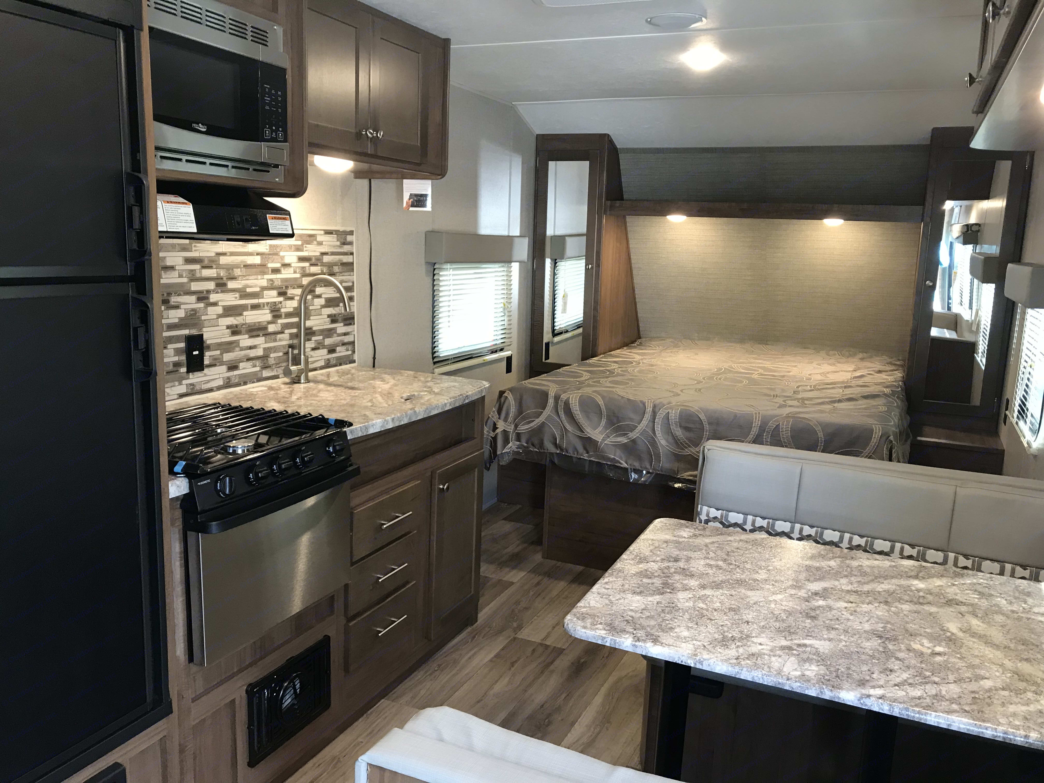 master queen bed, closets with rods on both sides, dinette folds into twin size bed,. ASPEN TRAIL 1900rb 2020