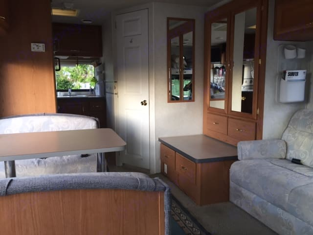Dining Table converts to bed (door in photo is to the bathroom). Ford Tioga 2002