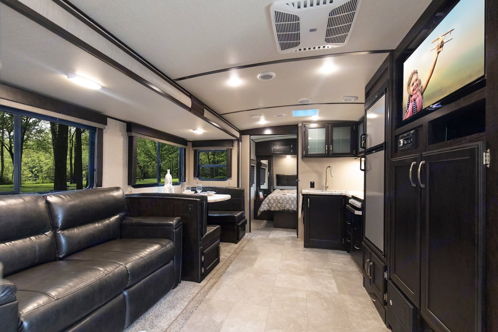 Interior - Sofa opens to full-size bed. Grand Design Imagine 2019