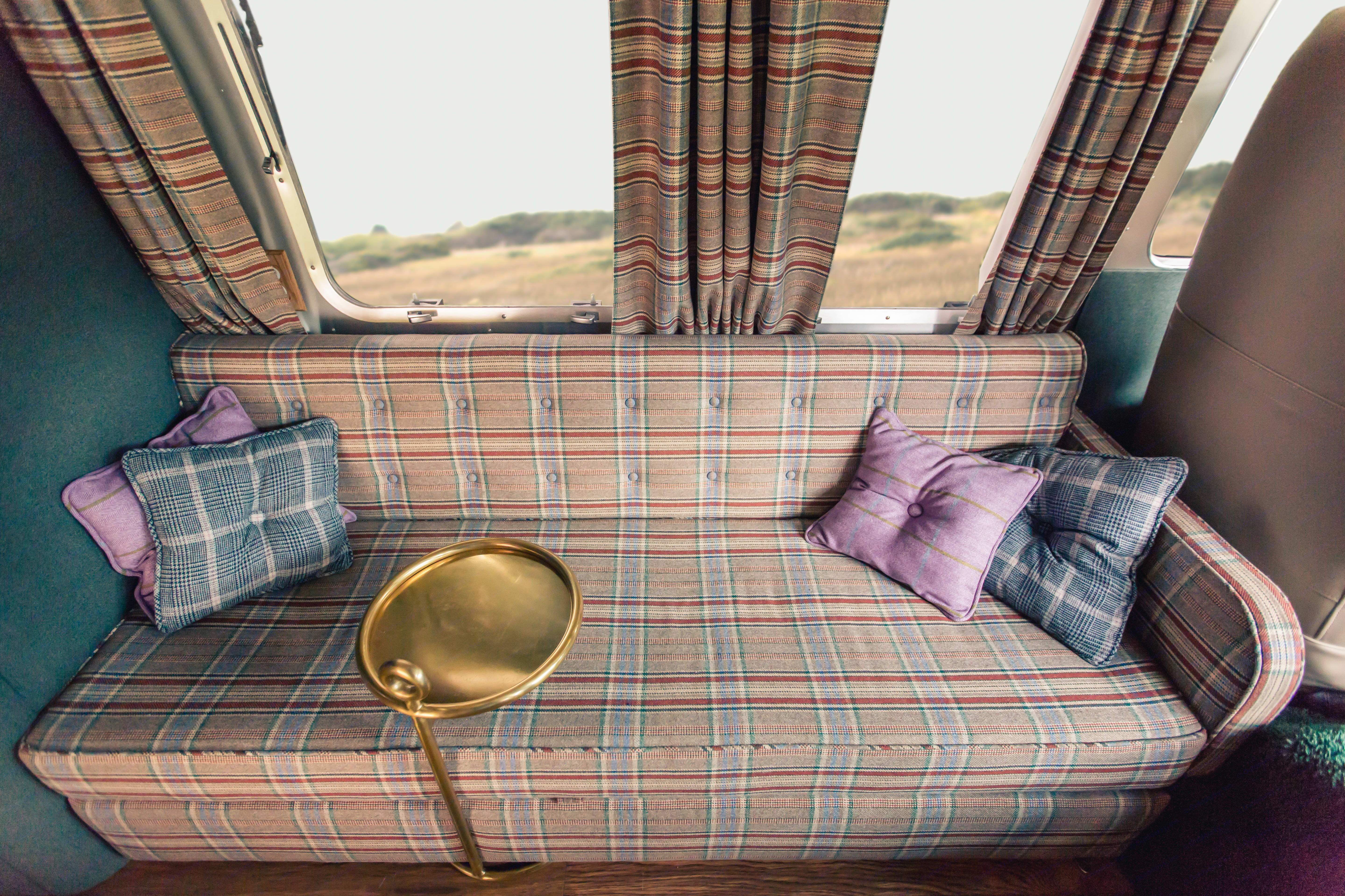 sofabed folded in living area. Airstream Excella 1981