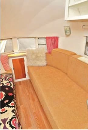 Couches convert into either a two single beds or a giant larger-than-king bed which easily sleeps 3. Airstream Airstream 1955