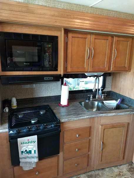 FULL KITCHEN WITH ALL DISHES AND UTENSILS POTS AND PANS. Coachman Pursuit 2015