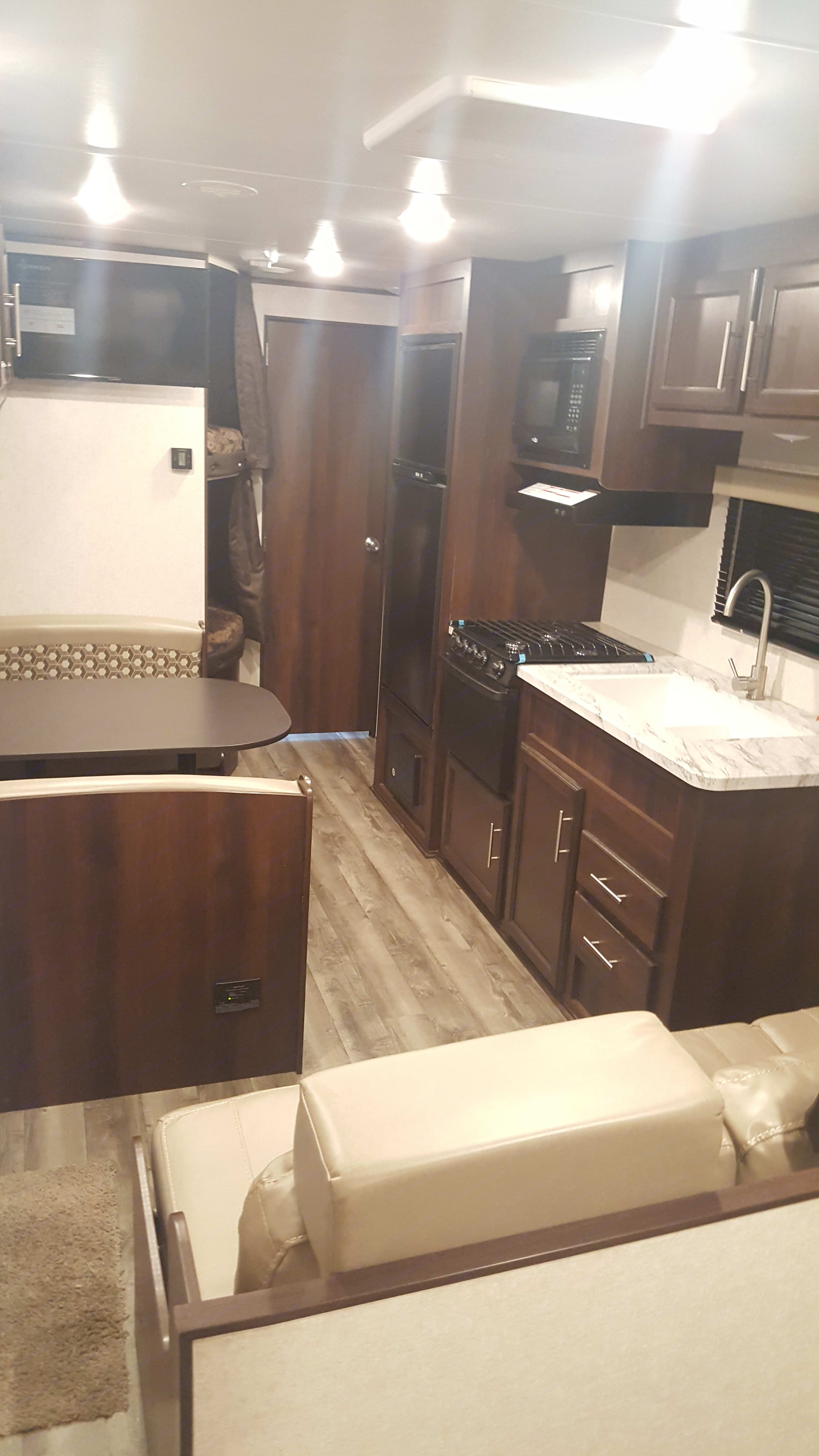 Big window next to dining gives natural sunlight when your cooking for family and friends.. Jayco Jay Flight 2019
