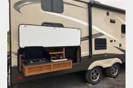 Outdoor Kitchen: 2 burners + Sink + Frig. Crossroads Sunset Trail 2016