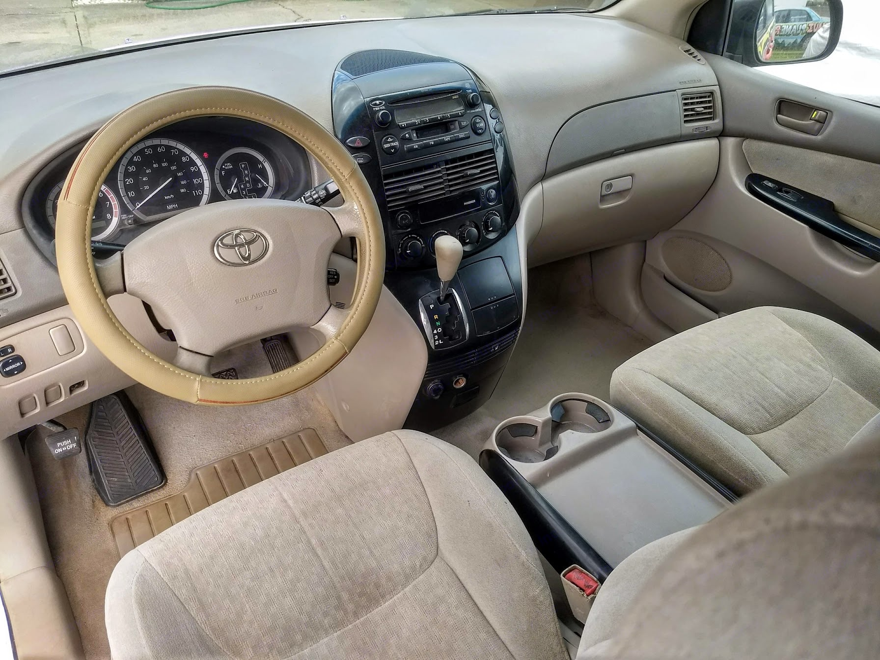 The Drivers cockpit features a next-gen wheel cover, providing a rich supple feedback loop; soft and comfortable, yet fully controllable.  All driver operations and systems are intuitively laid out.  Instrumentation is robust; Experience the pure joy of the drive!. ToyotAloha Sienna Special 2004