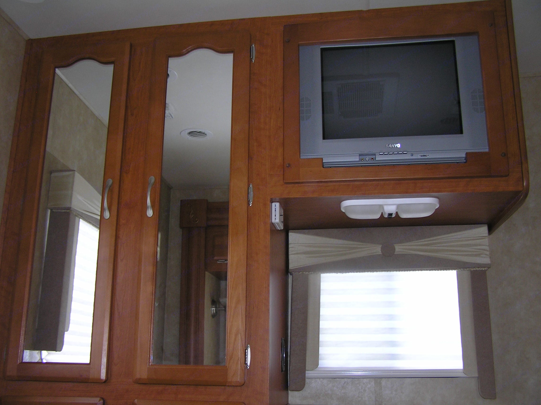 Master bedroom, closet and HD tv. Forest River Georgetown 2007