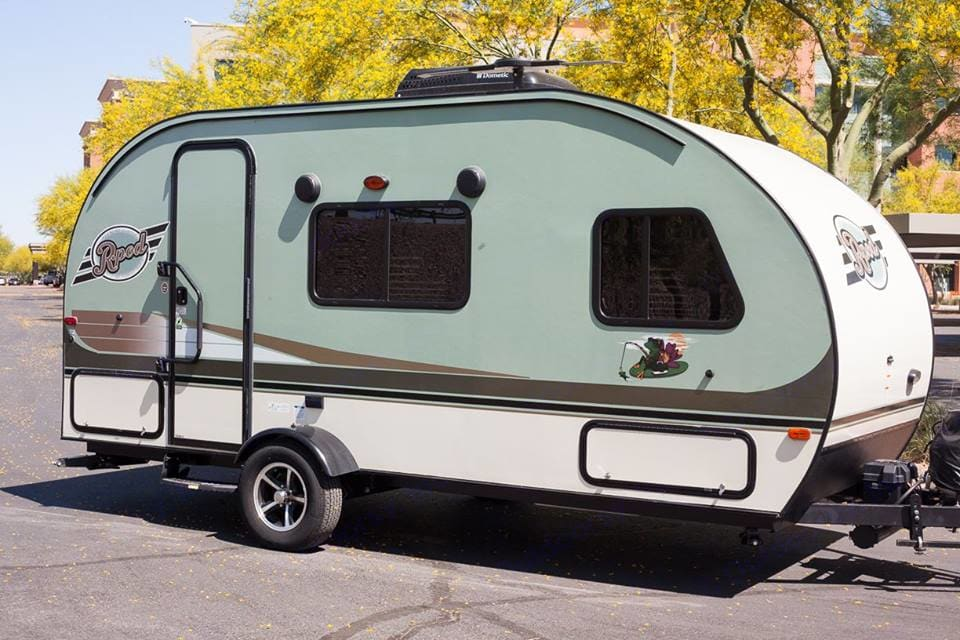 Exterior of 2016 r-pod 180. Outdoor speakers, front door, and extra outside storage compartments. . Forest River R-Pod 2016