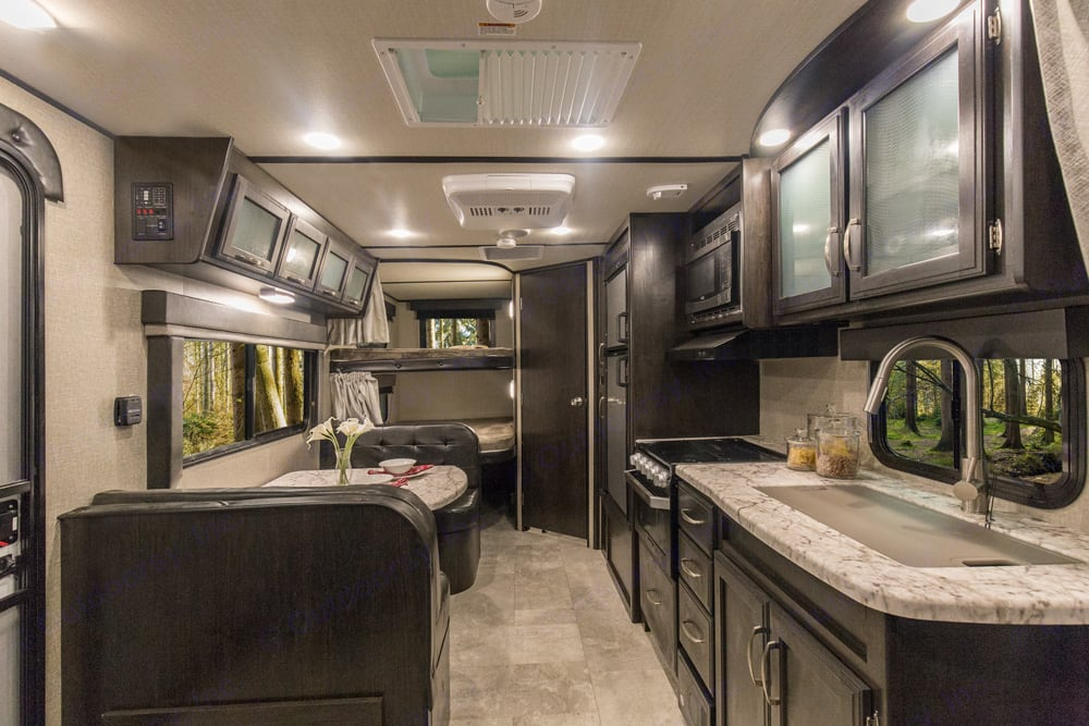 living room and large 400lbs capacity double bunks . Grand Design Imagine XLS21bhs 2019