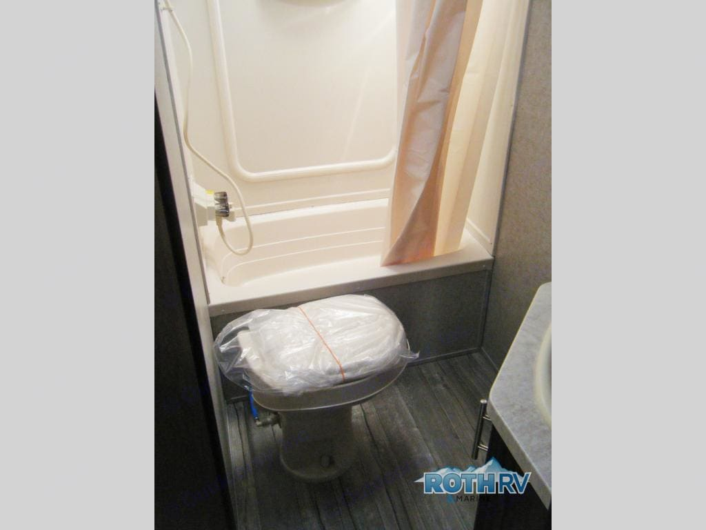 Spacious bathroom with shower-tub and separate sink. Forest River Cherokee Grey Wolf 2018