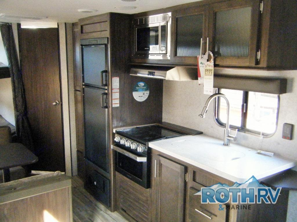 Kitchen with large fridge an lots of space. Forest River Cherokee Grey Wolf 2018