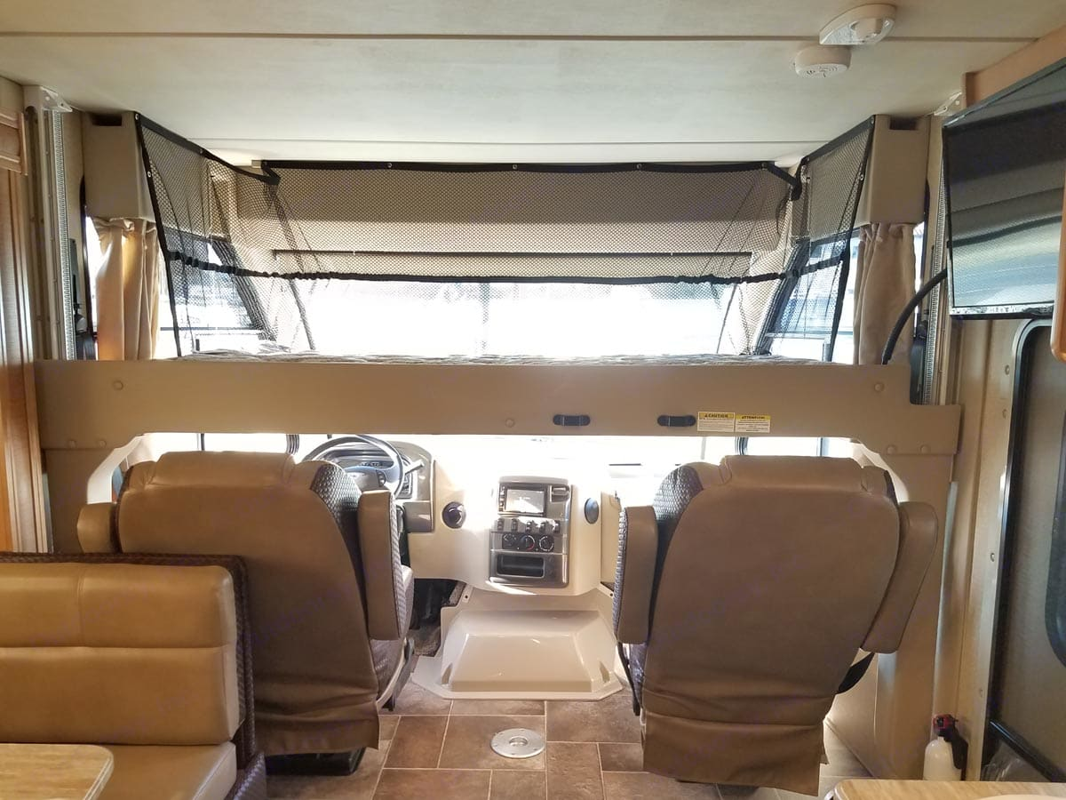 twin bed lowers from ceiling . Thor Motor Coach Axis 2016