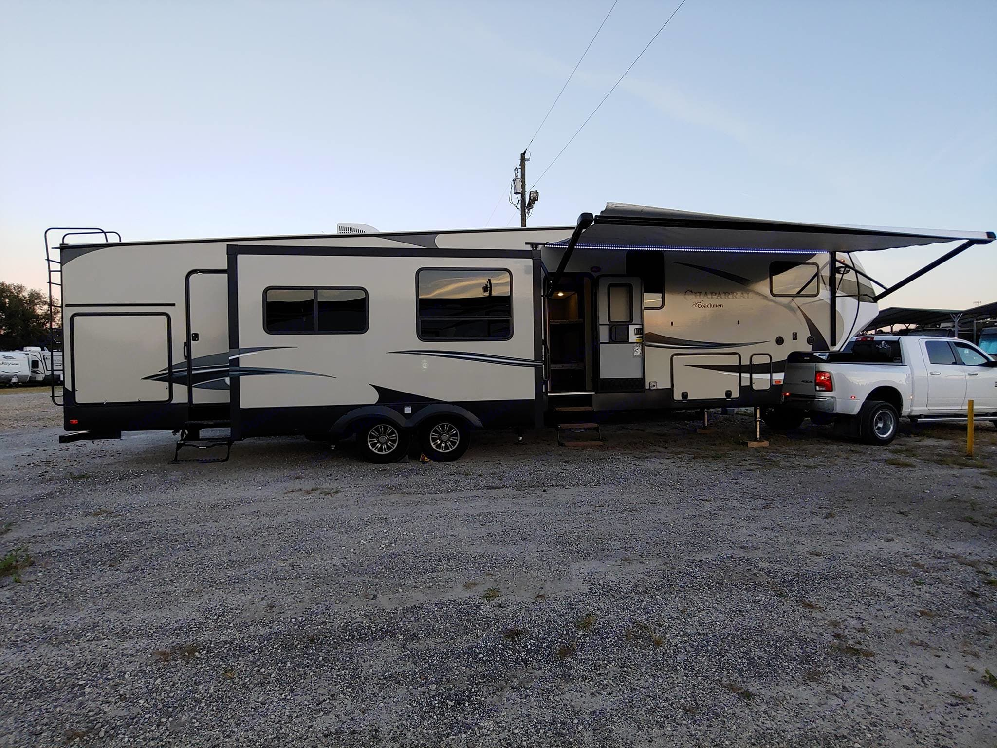 Large awning with LED lights, living room slide, 2 entrances and outdoor kitchen. Coachmen Chaparral 2017