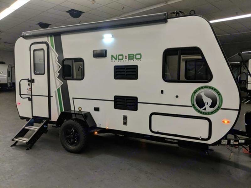 Entrance door with steps down; under the front window is the storage compartment. Forest River NOBO 16.8 Easy to tow Trailer 2019