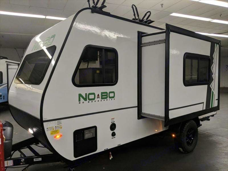 Slide-out where the couch is inside.. Forest River NOBO 16.8 Easy to tow Trailer 2019