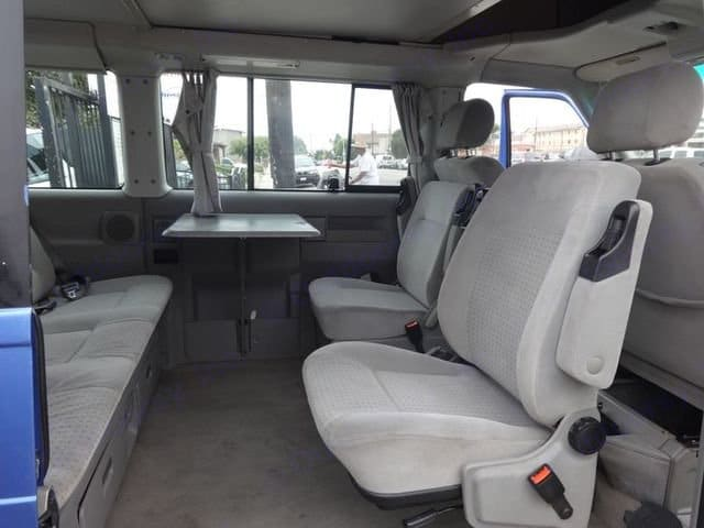 Interior set up with table and opposing seats.  Under-seat cooler to keep food and beverages cold.. Volkswagen VW Eurovan Weekender 2001