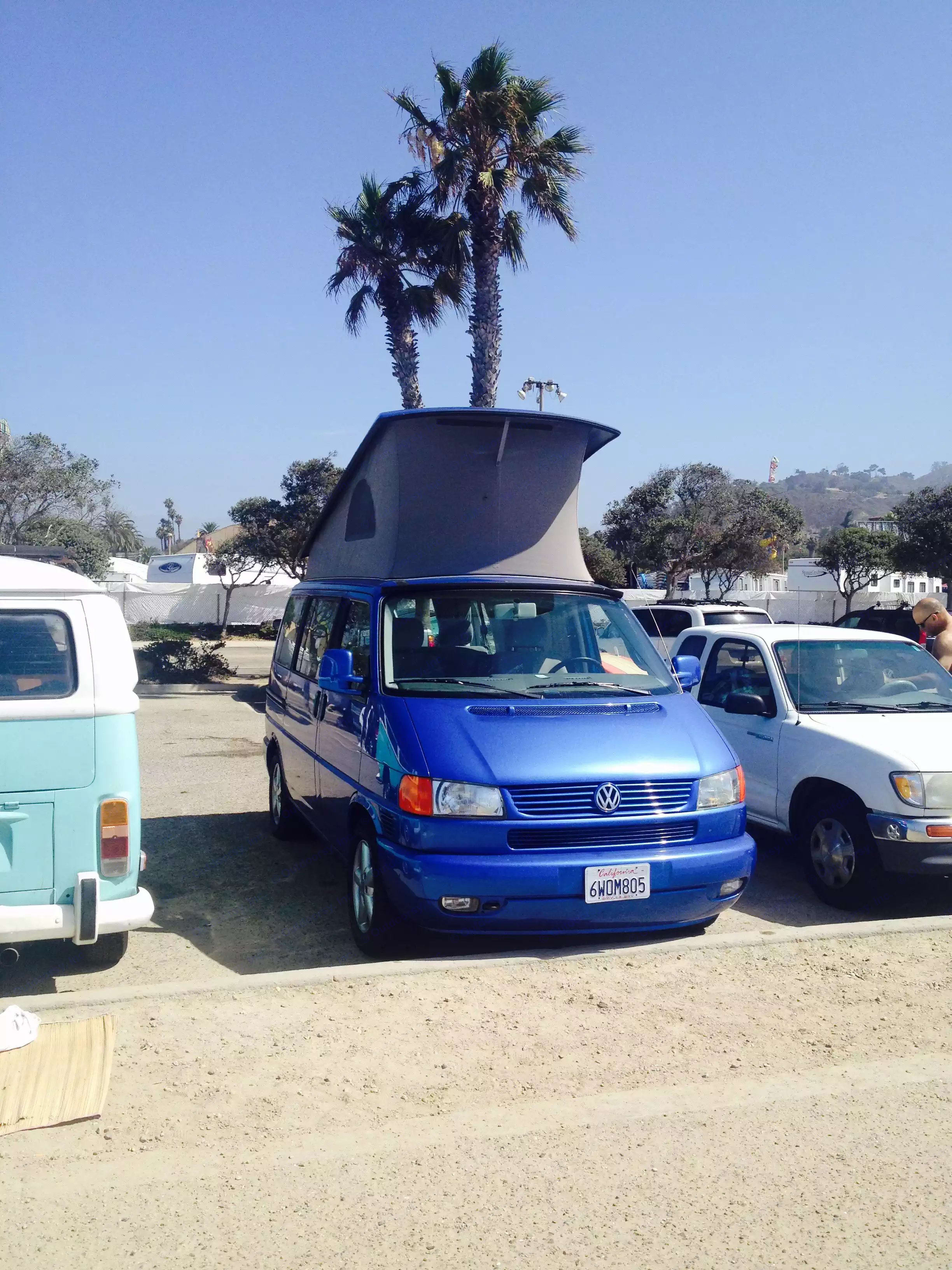 At the beach with the top popped up.  Sleeps four comfortably.  Yakima roof rack can be used to carry extra gear, canoes, kayaks, surfboards.. Volkswagen VW Eurovan Weekender 2001