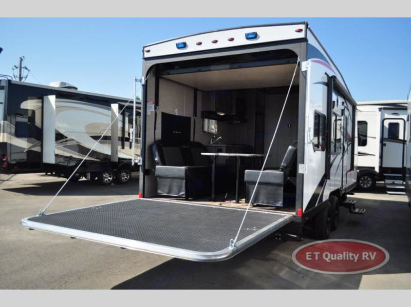Ramp/Patio open. Guest bed is raised in this photo. Pacific Coachworks Powerlite 2018