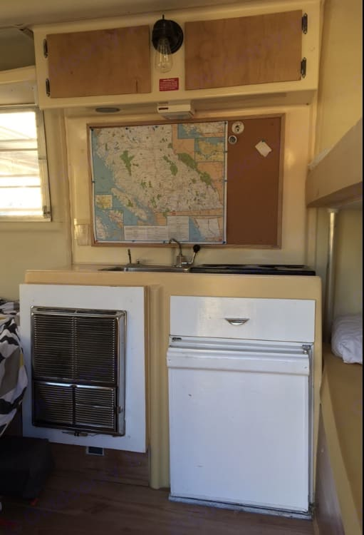 A look inside from the door. Double bunks to your right upper bed rail not shown in photo) and dinette/double bed on the left. . Trillium Rv Other 1976