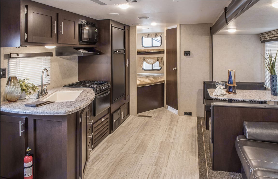 Double bunk in the back left, full bathroom to the right; slide out adds extra living space for the dinette and couch.. K-Z Manufacturing Sportsmen 2017