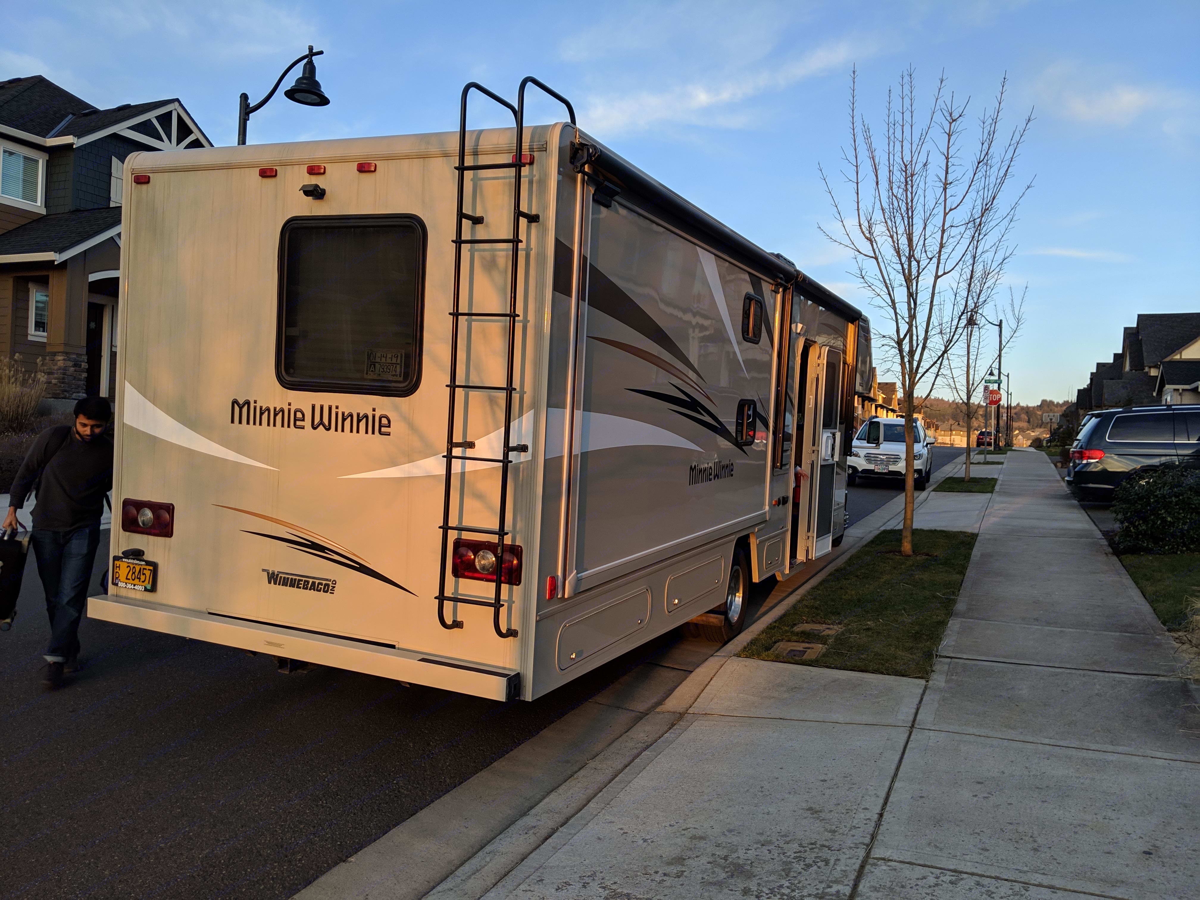 rear exterior passenger side, pull out not extended, rear view camera visible, hitch can be used to haul a trailer or boat. Winnebago Minnie Winnie 2017