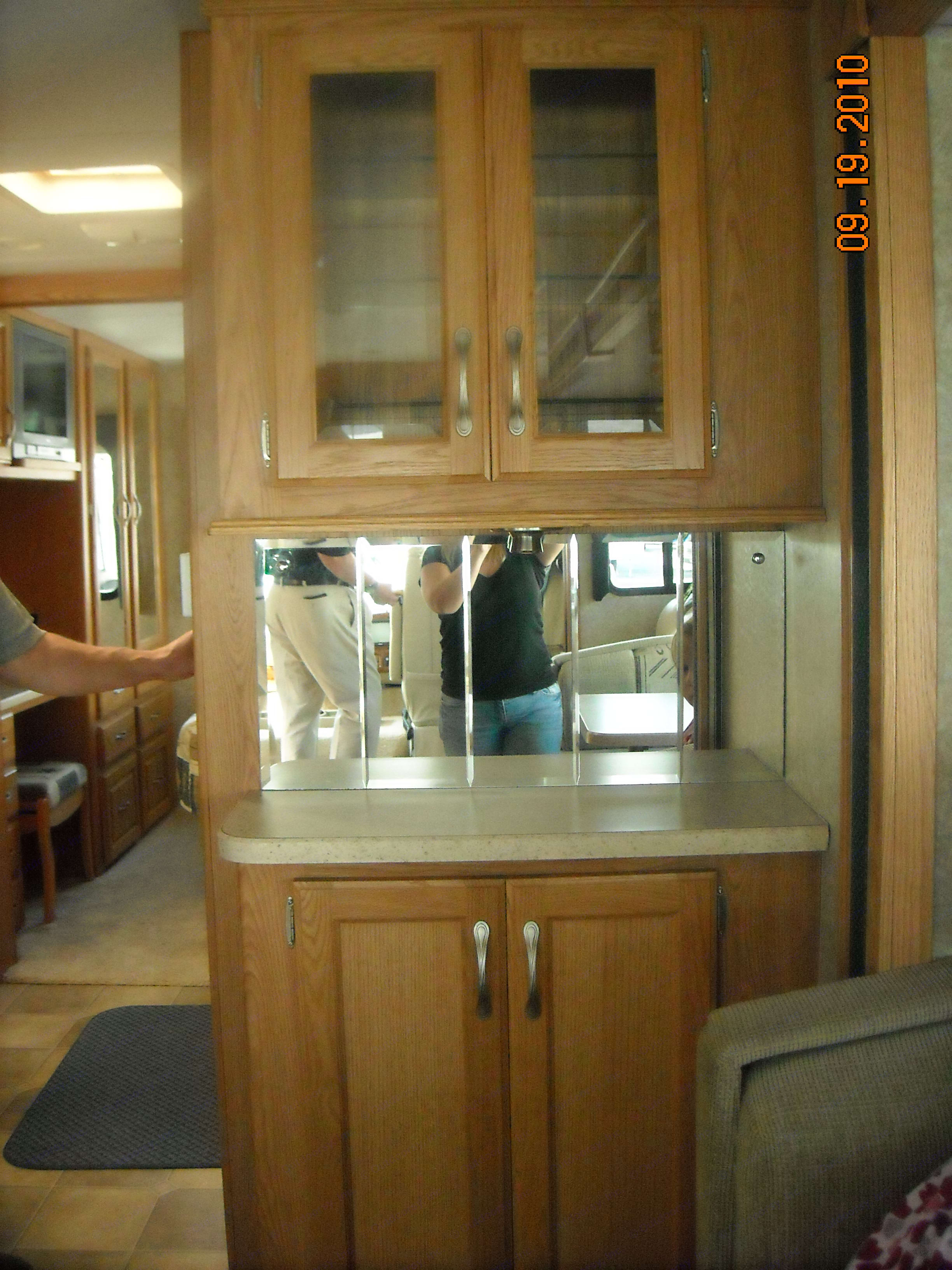 bar, bar, bar and bar.  built in bottle rack, so your beverages travel safely. Thor Motor Coach Hurricane 2006
