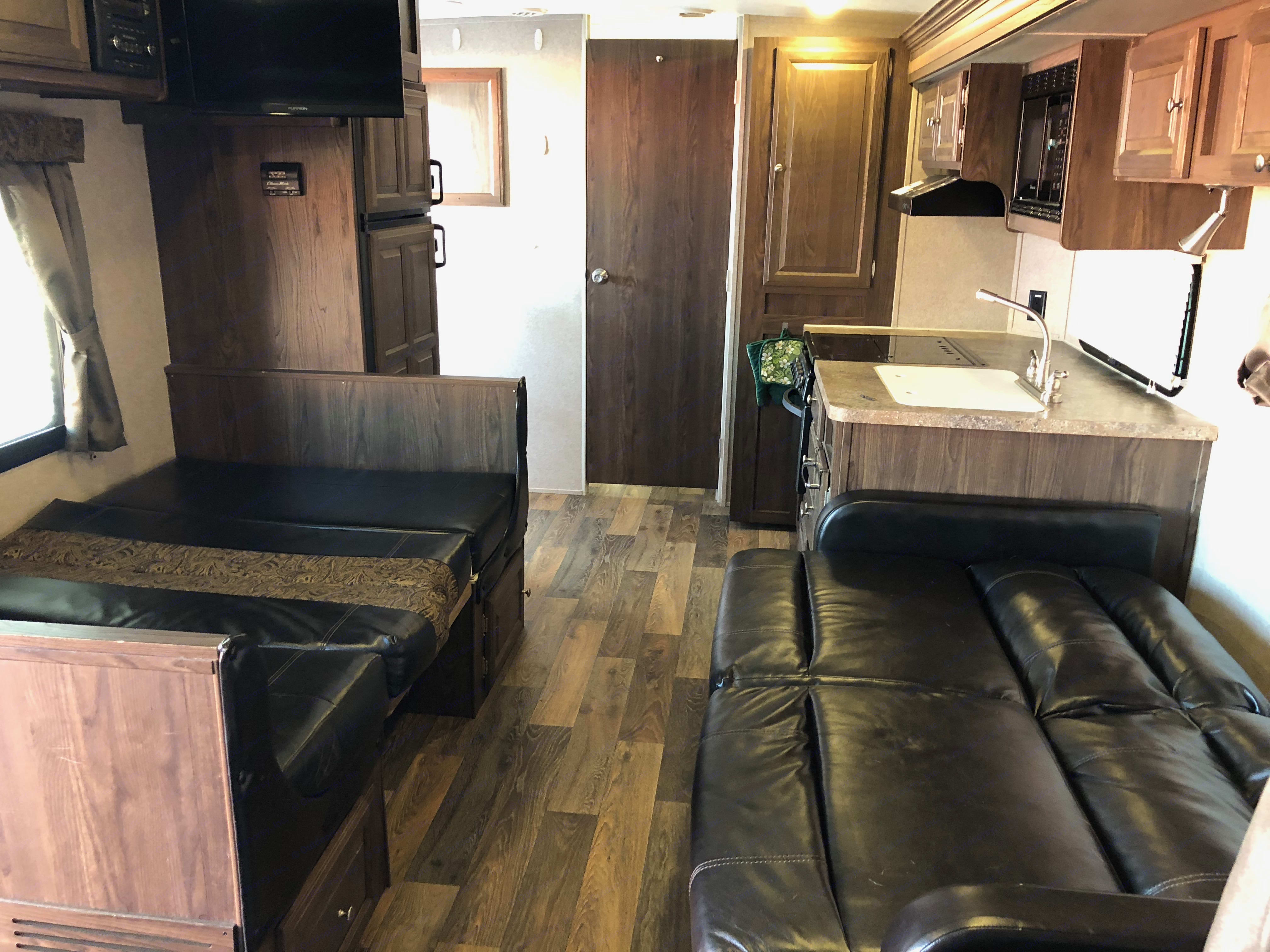 Table and sofa convert to sleeping space. . Forest River Rockwood Mini Lite 2016