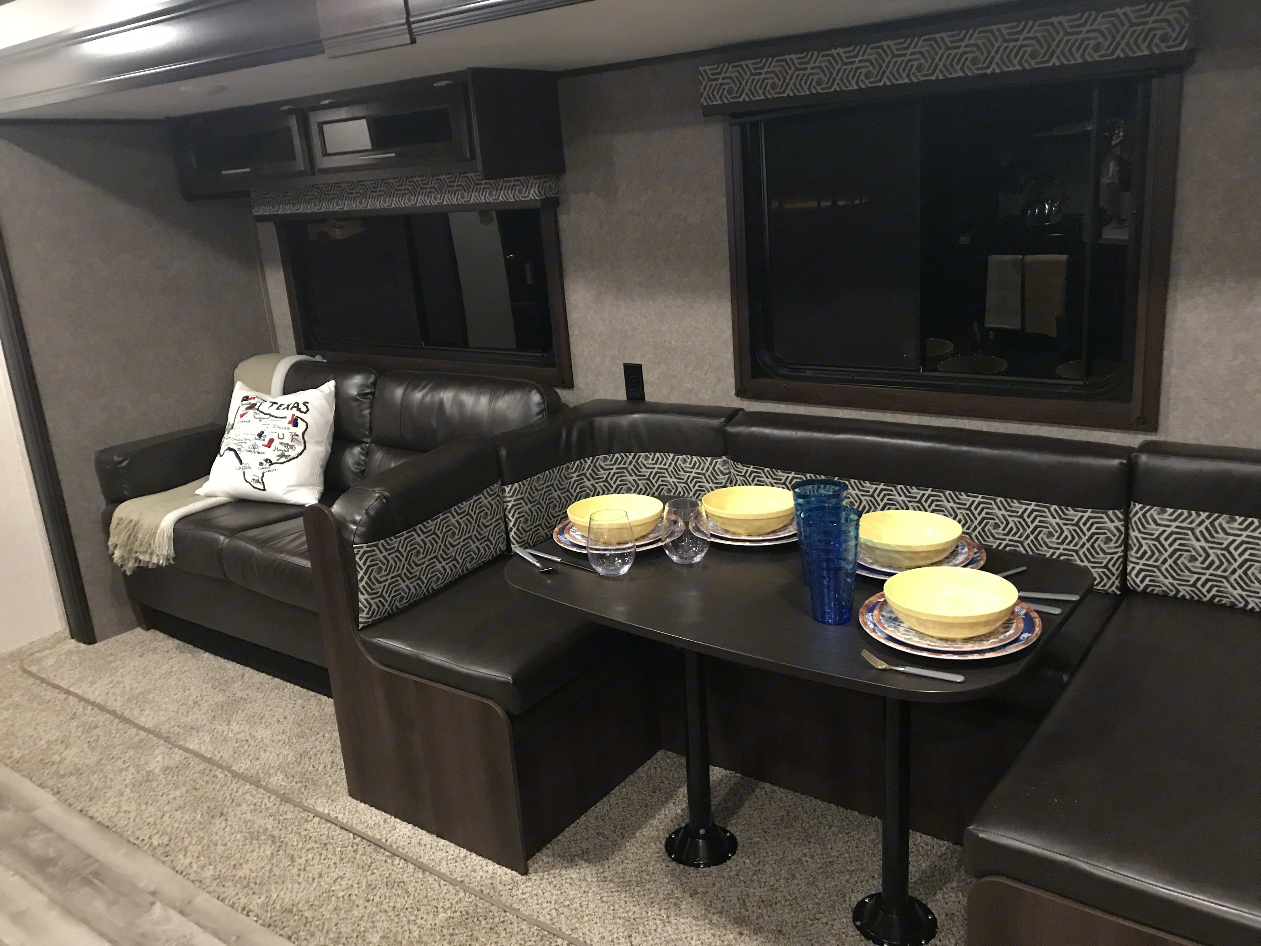 Another view of living/dining area with some plates and bowls out. Jayco Flight 284BHS SLX 2019