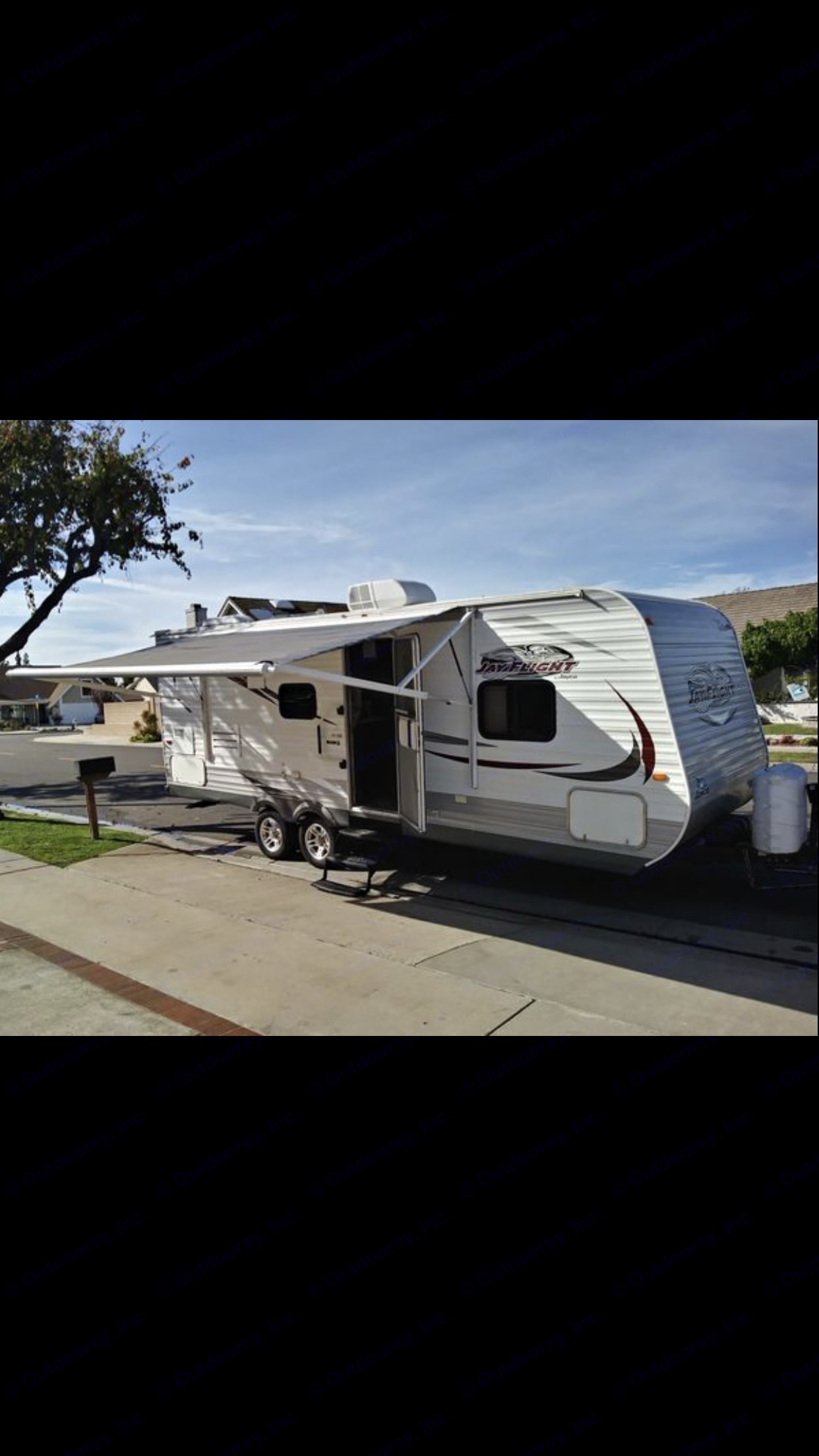 Another view with the awing out . Jayco Jay Flight 2014