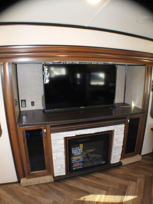 "50""  Retractable TV, DVD/CD/Surround Sound System and Electric Fireplace. Jayco North Point 2017"