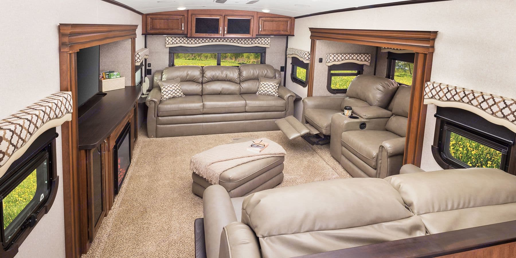 Raised Full Den with two Hide abed (queen & double) and two Entertainment Center Rocking Chairs (leather). Jayco North Point 2017