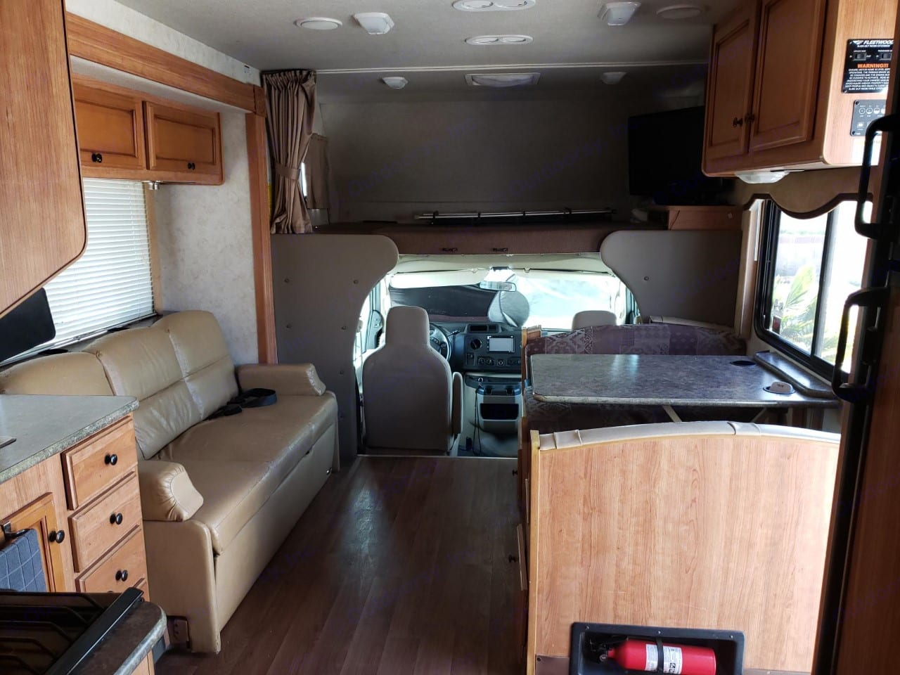 Overhead full size bunk; Dining table and Fold out sofa. . Ford E450 2012