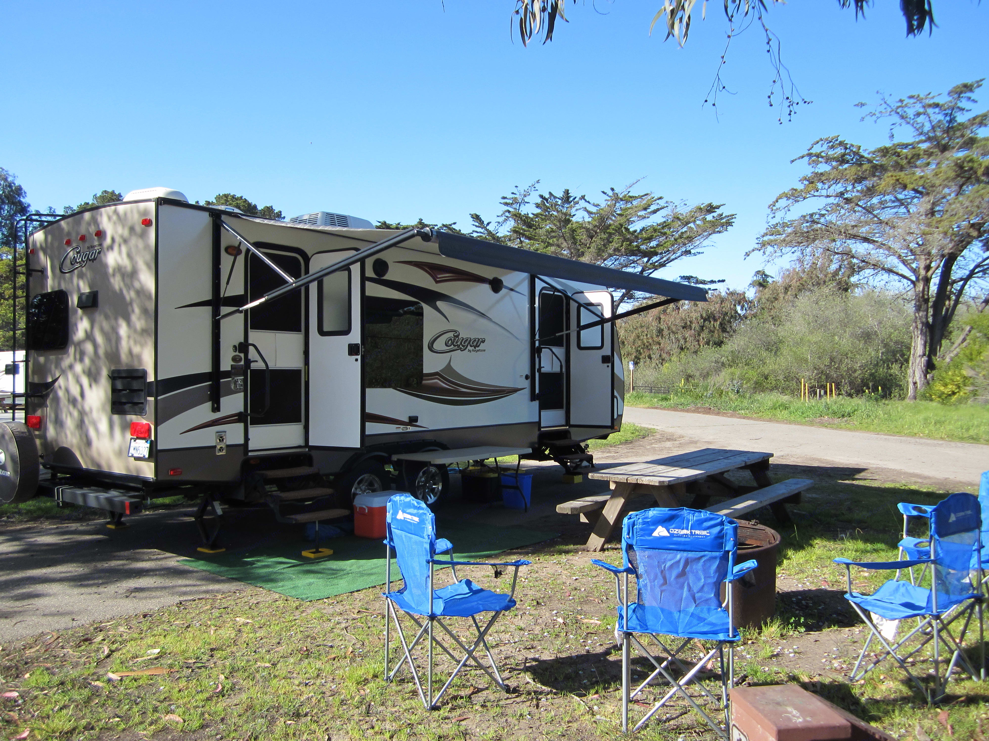 Campers view, great access to the trailer from both the master bedroom and kitchen areas. Nice large electric awning, exterior speakers and LED lighting for all of your outside camping needs.. Keystone Cougar 2016