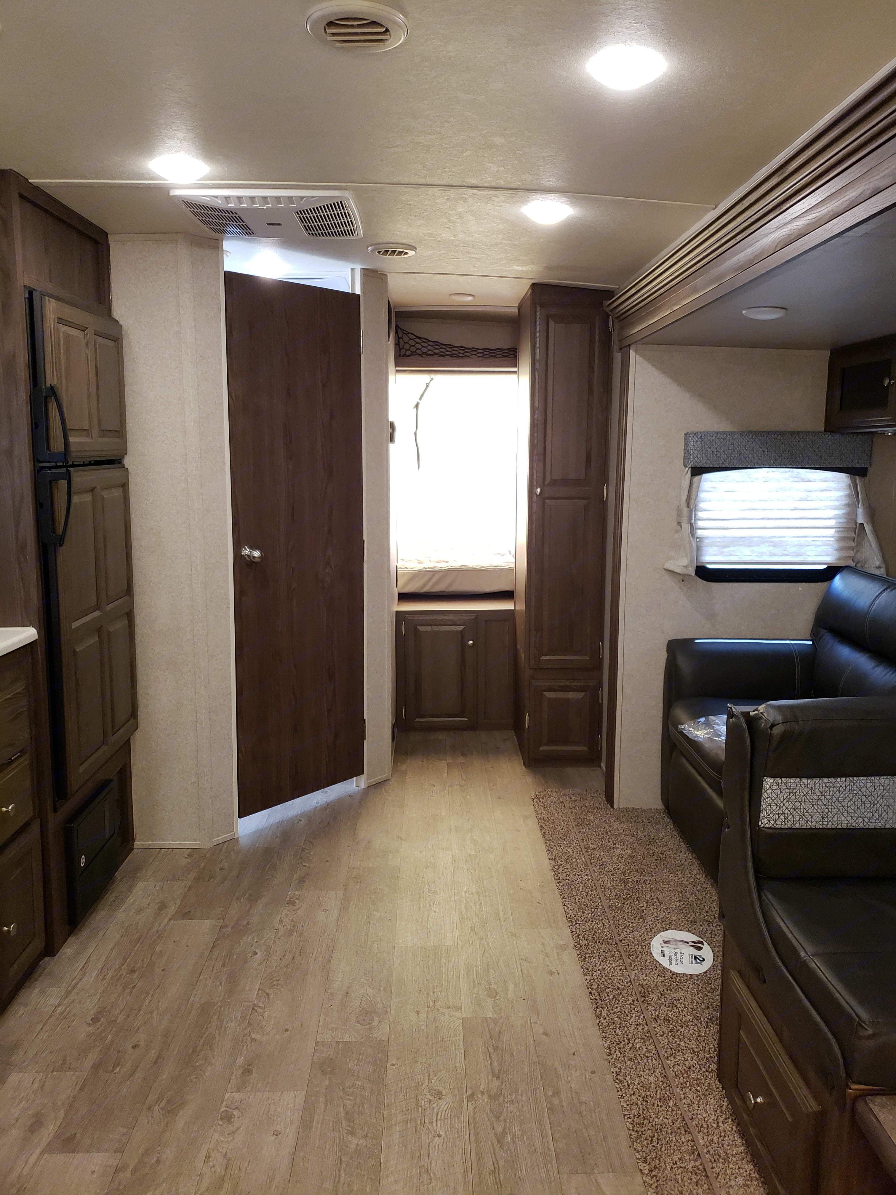 This picture was taken from the front of the trailer, the kitchen is to your left, the (fold out) sofa and dining area is on the right. Note: the back sleeping area (straight back) is not opened up in this picture.. Forest River Rockwood Roo 2019