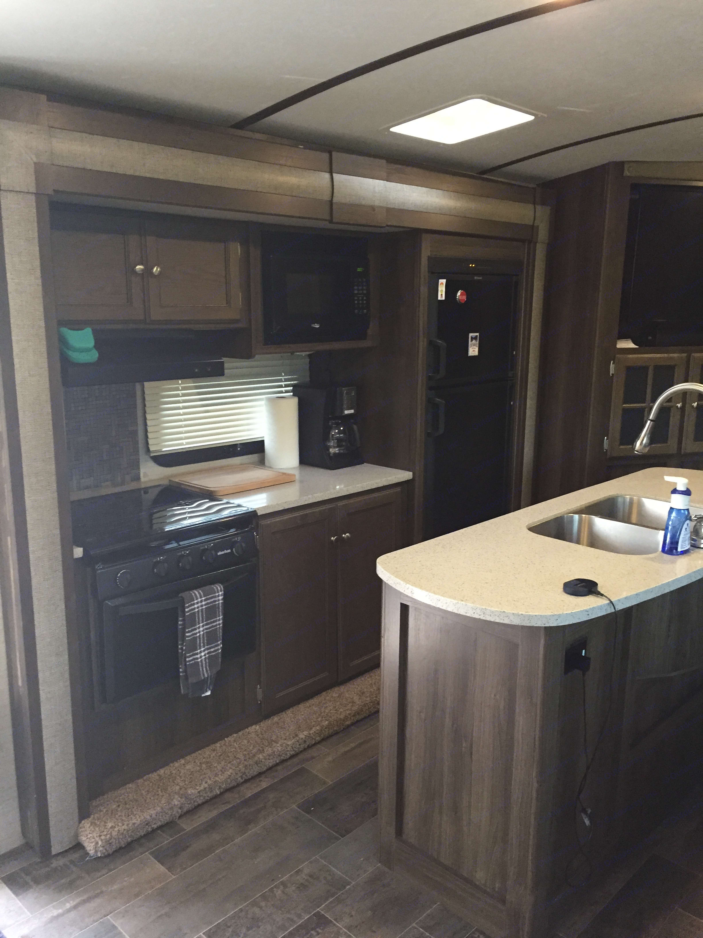 Kitchen stocked with dishware, coffee maker, toaster, gas stove/oven, microwave and fridge/freezer.. Keystone Bullet Premier 2017