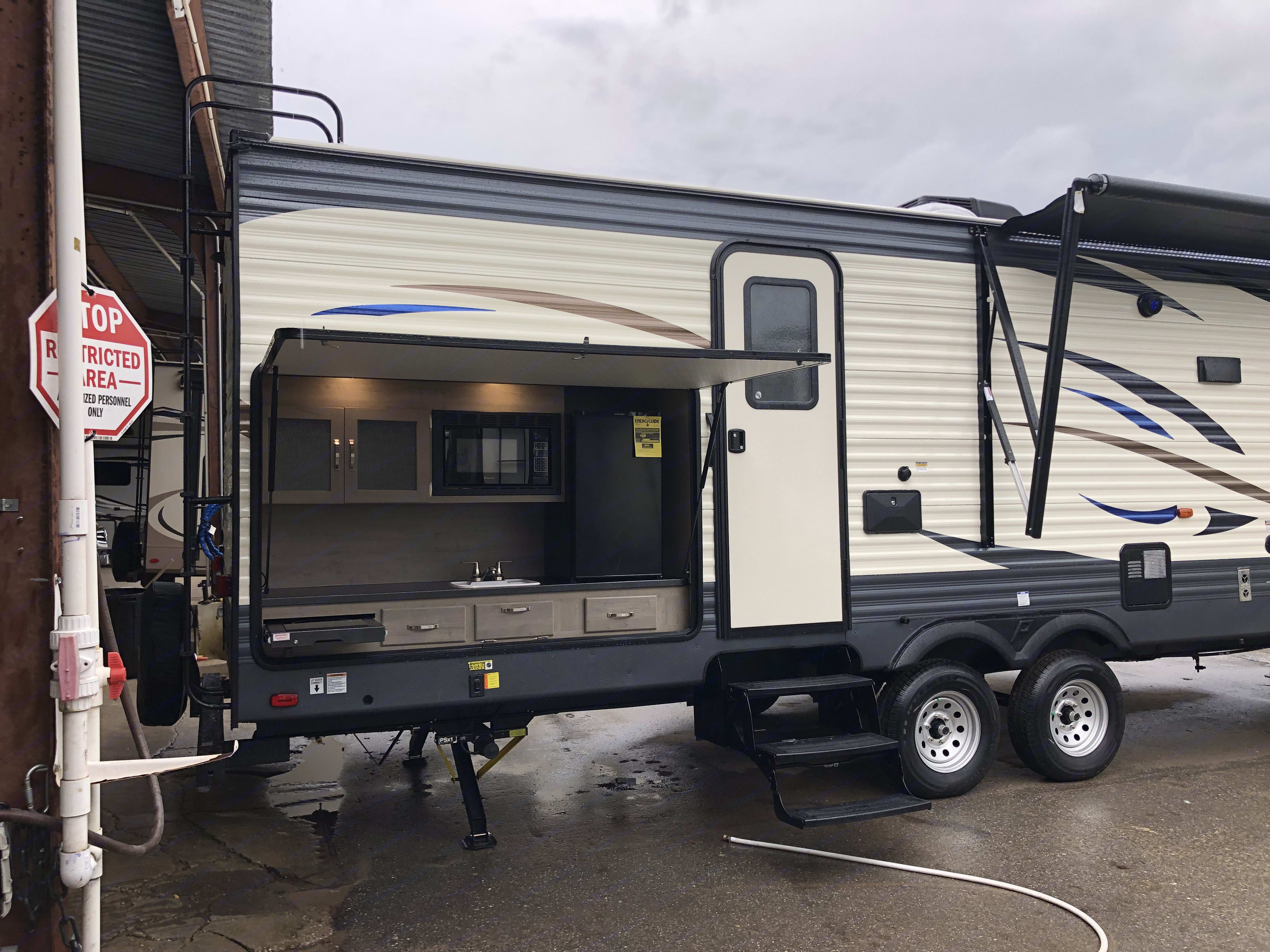 Outside kitchen, outside shower (black box next to the door), awning.. Palomino Puma 2019