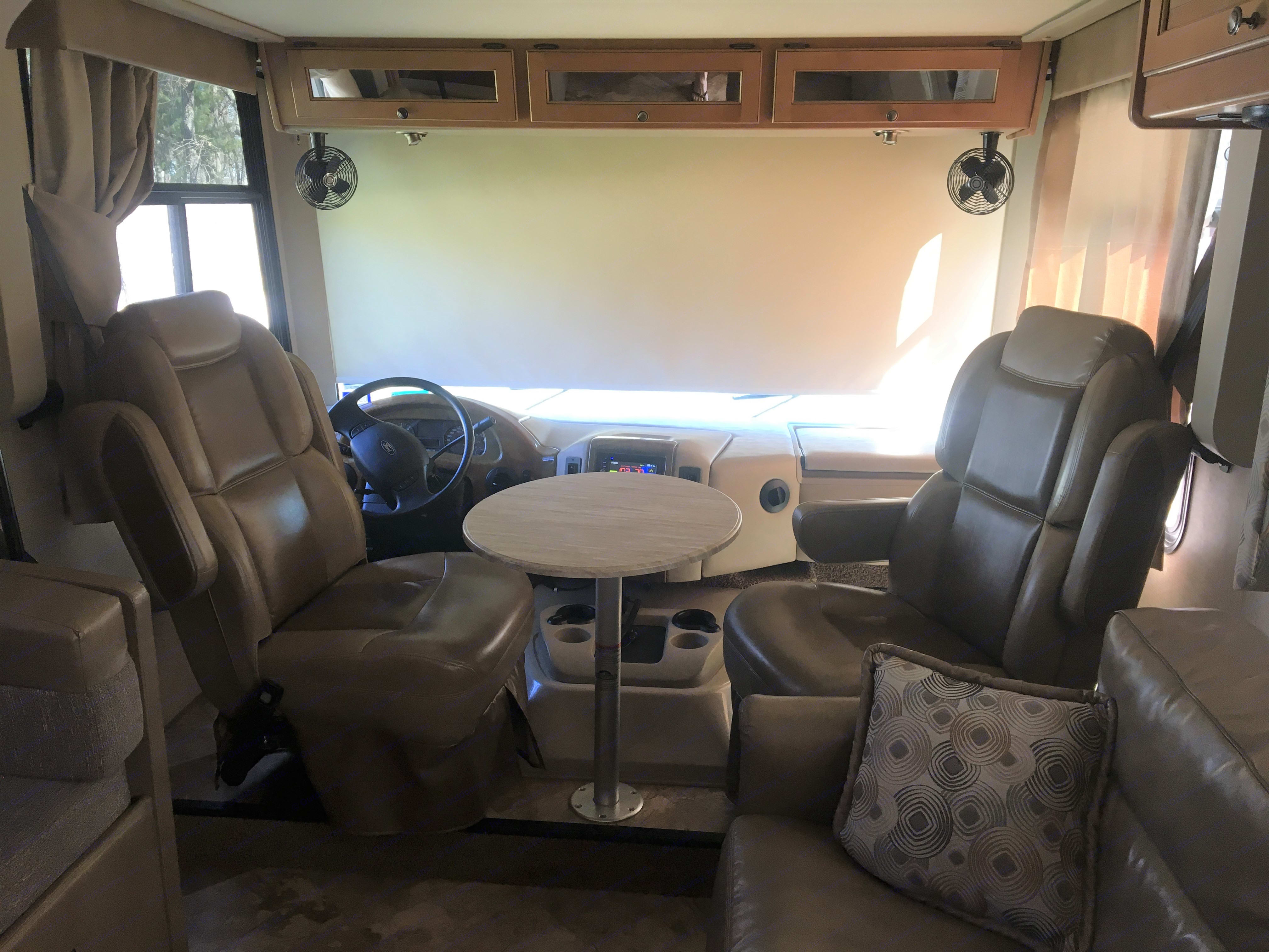 During the day the captain's chairs & cocktail table provide additional seating. Electric sunshade provides privacy.. Thor Motor Coach Windsport 2016